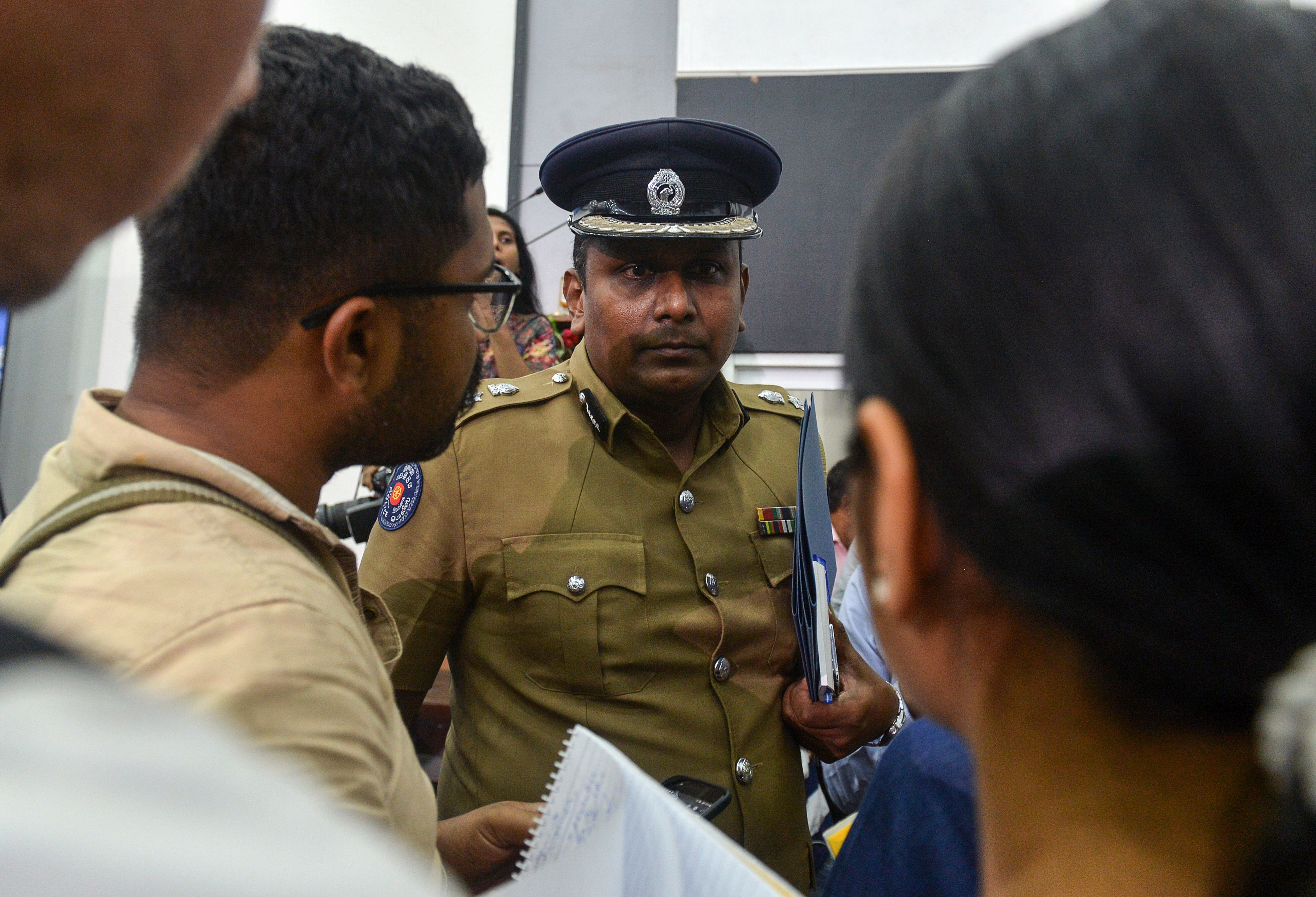 Sri Lanka's police spokesman Ruwan Gunasekera (C) said most of the suspects were arrested in the capital, Colombo