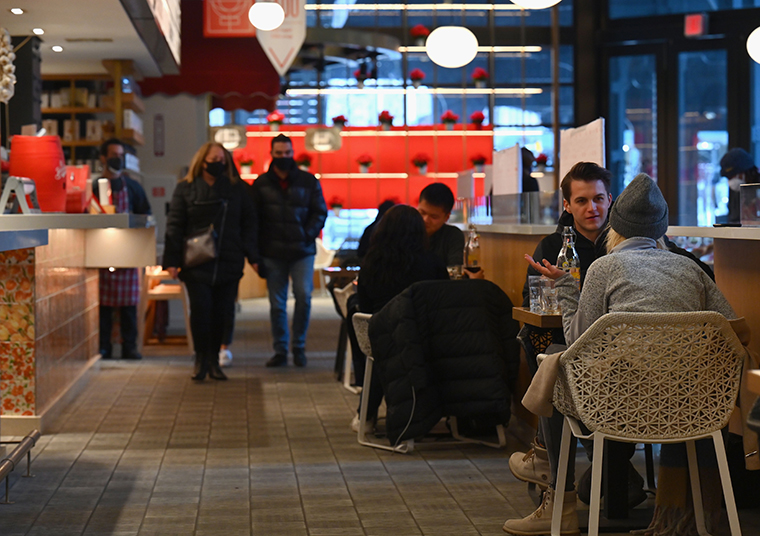 People dine at a restaurant at Hudson Yards on February 12, 2021 in New York City as restaurants were to reopen for indoor dining at 25 percent capacity.