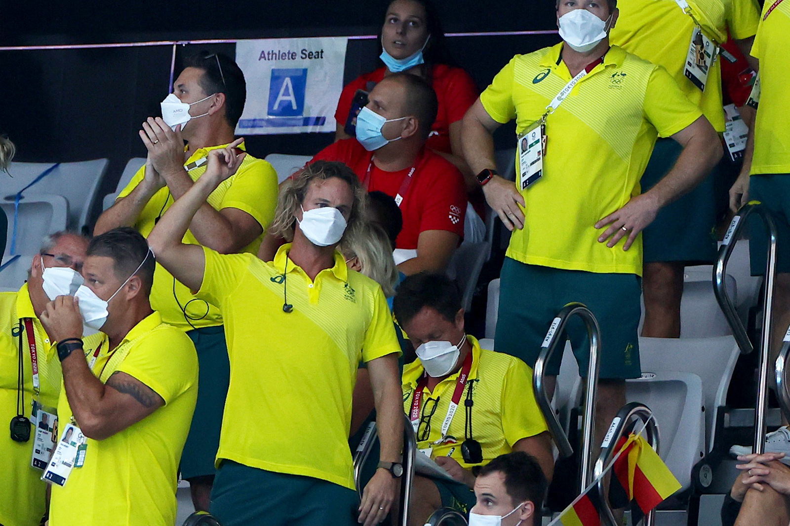 Australia swimming coach Dean Boxall celebrates as Ariarne Titmus of Australia sets a new Olympic record to win the gold medal on July 28.