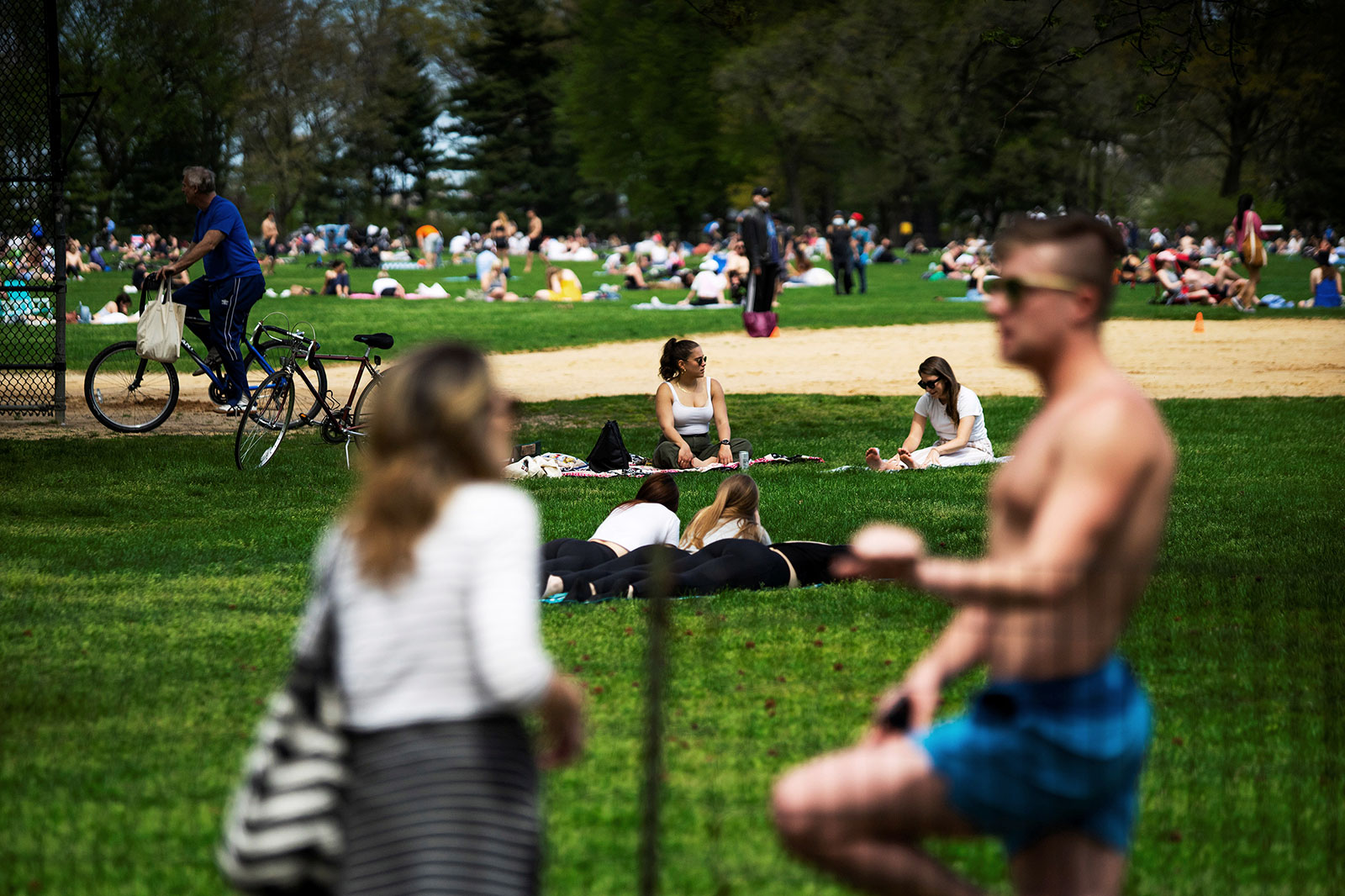 People enjoy a day of sunshine in New York's Central Park on May 2.