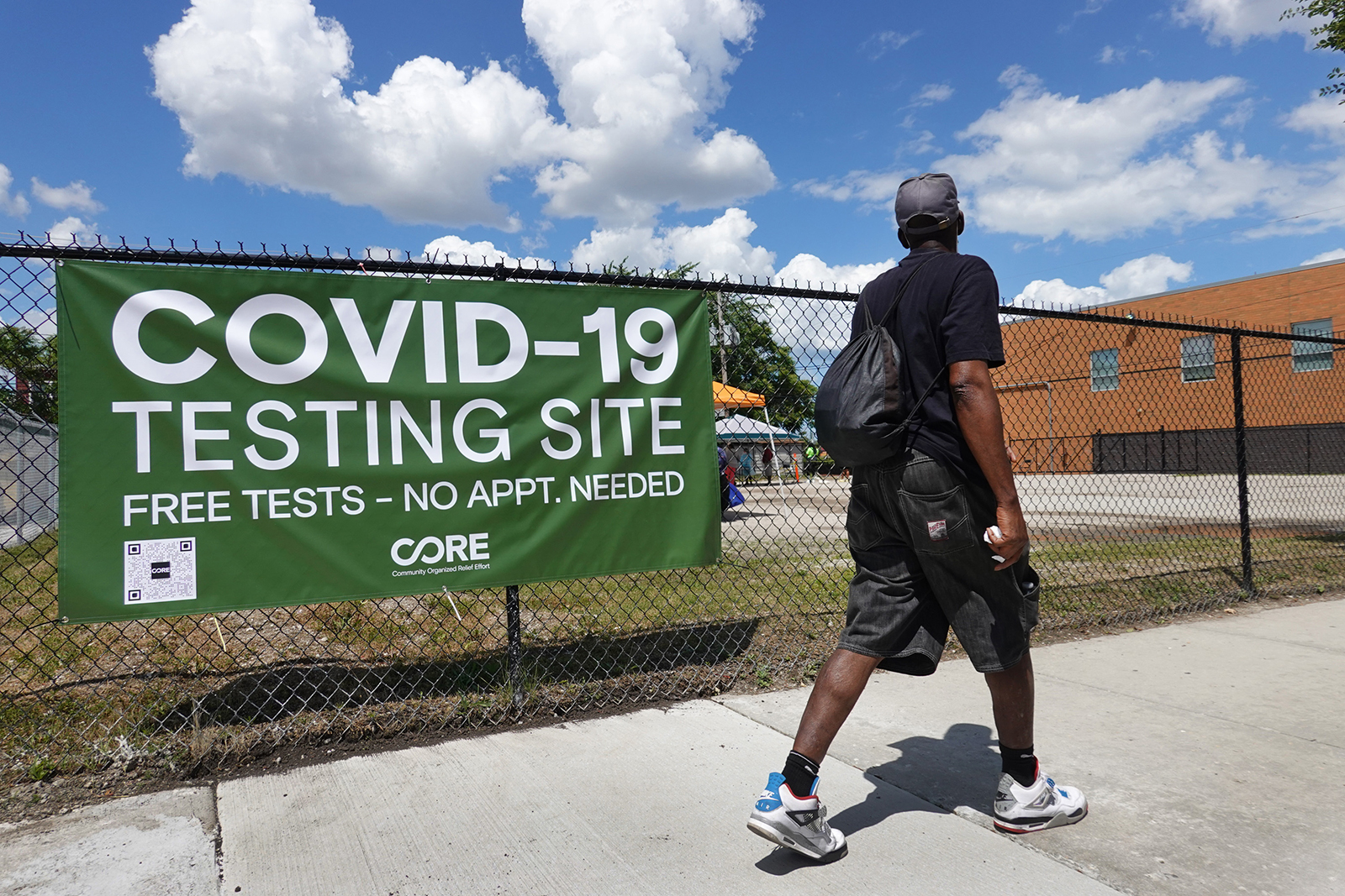 A sign alerts residents to a mobile COVID-19 testing site set up on a vacant lot in the Austin neighborhood on June 23 in Chicago.