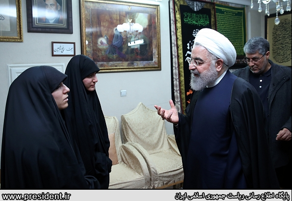 This photo released by the Iranian presidency shows Rouhani meeting Soleimani's family.