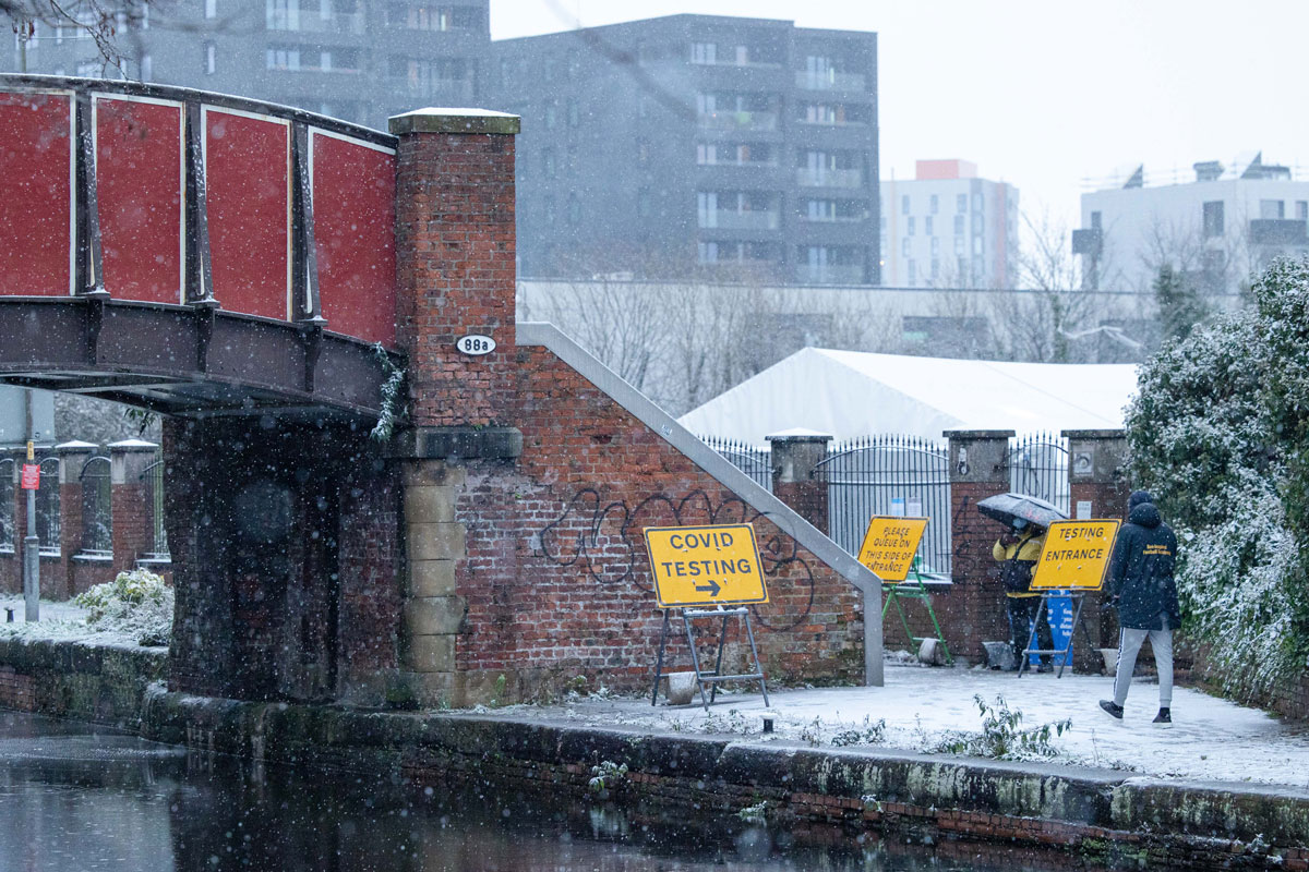 A Covid-19 testing site continues to operate in Manchester as snow hits the UK on December 29.