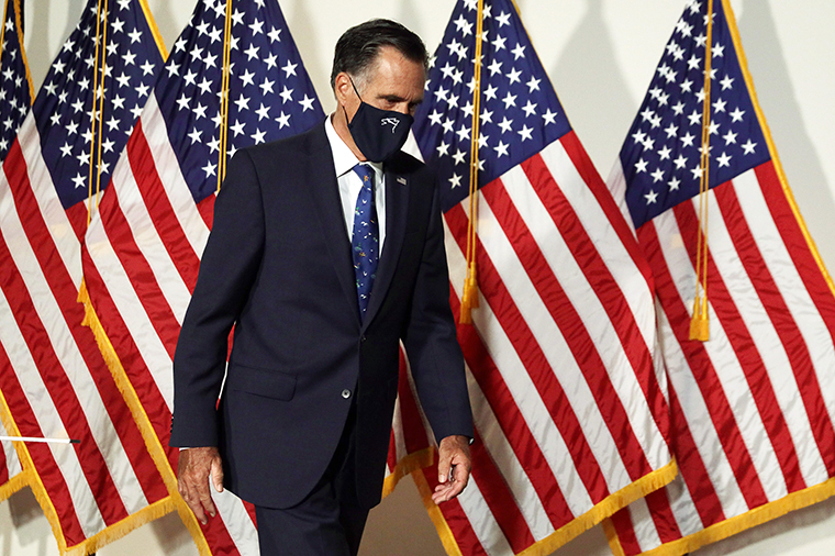 US Sen. Mitt Romney arrives at the weekly Senate Republican policy luncheon at Hart Senate Office Building Wednesday, September 9, on Capitol Hill in Washington, DC.