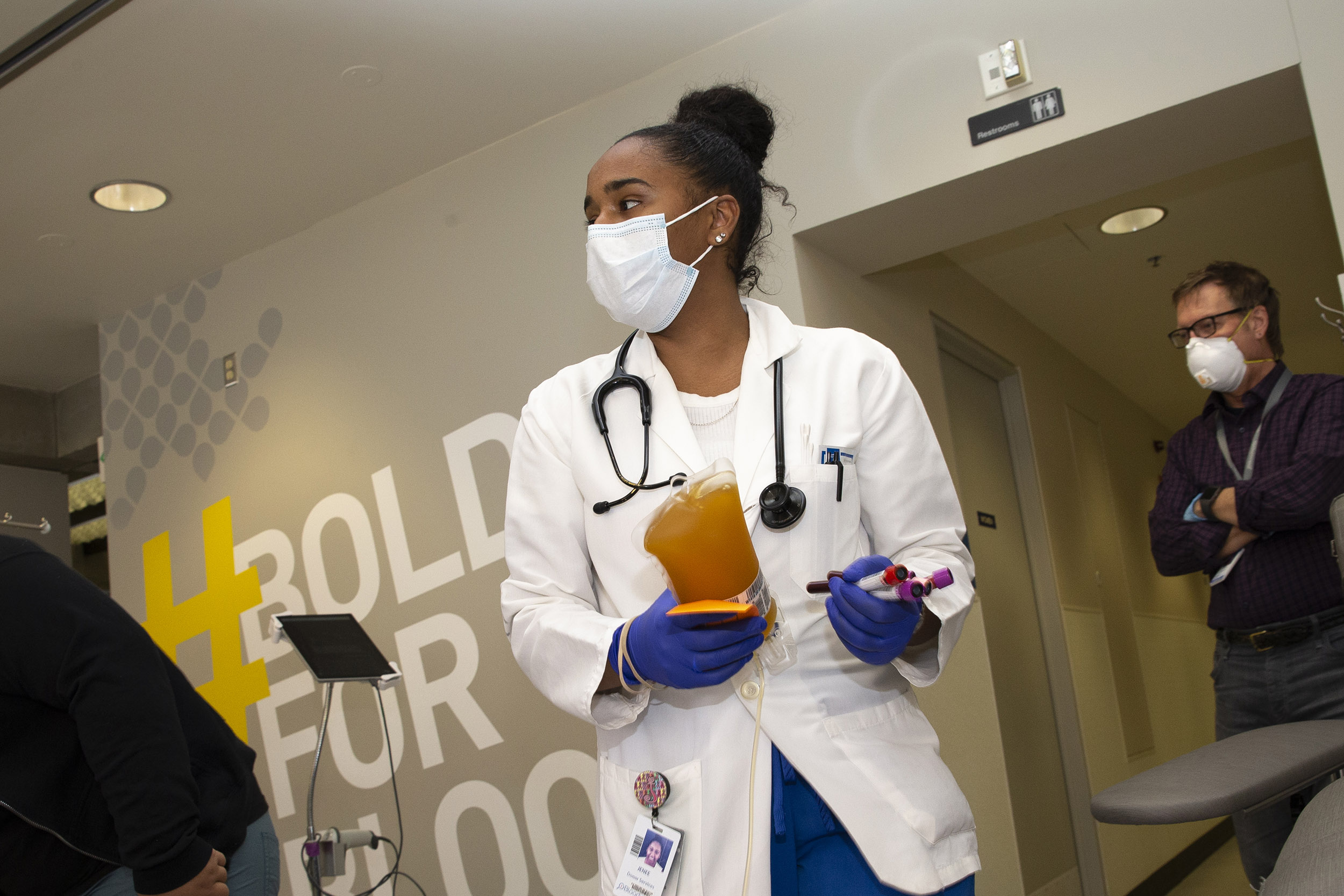 A medical worker carries Covid-19 convalescent plasma from a donor at Bloodworks Northwest on April 17, in Seattle, Washington.