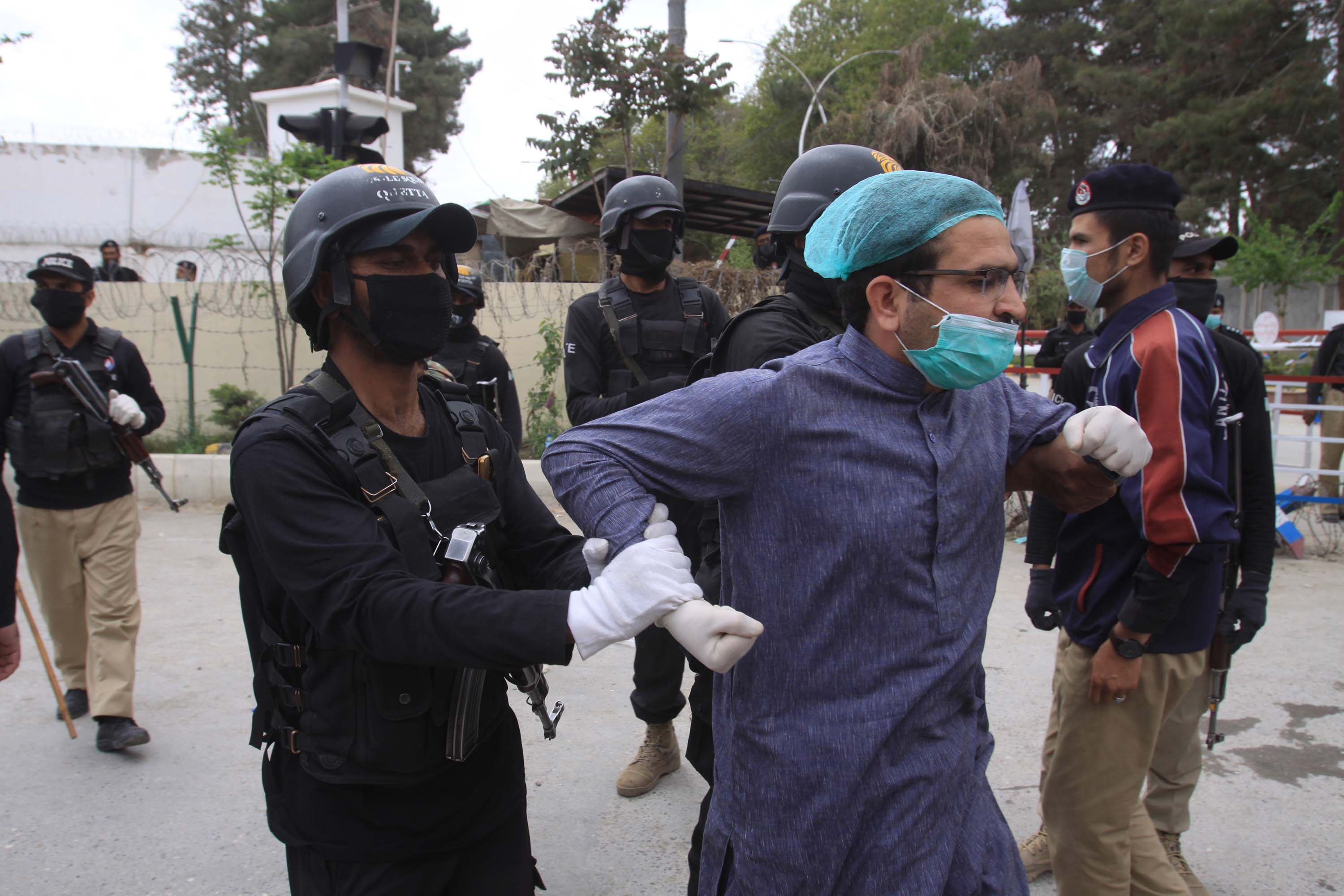 Police detain medical personnel demanding better facilities and personal protective equipment while caring for coronavirus patients in Quetta, Pakistan, on April 6.