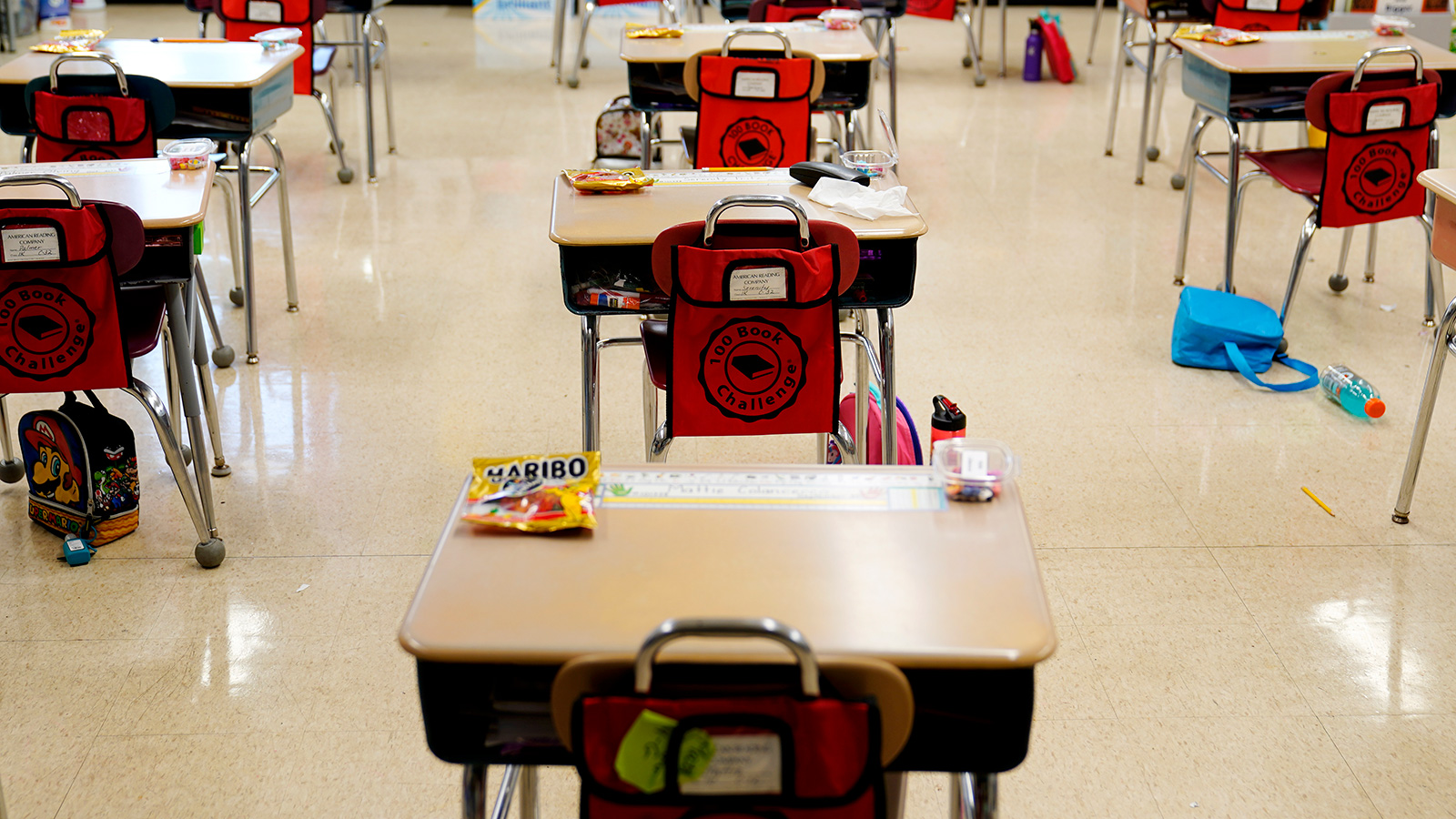 On this Thursday, March 11, 2021, desks are being arranged in a classroom at an elementary school in Nesquehoning, Pennsylvania.