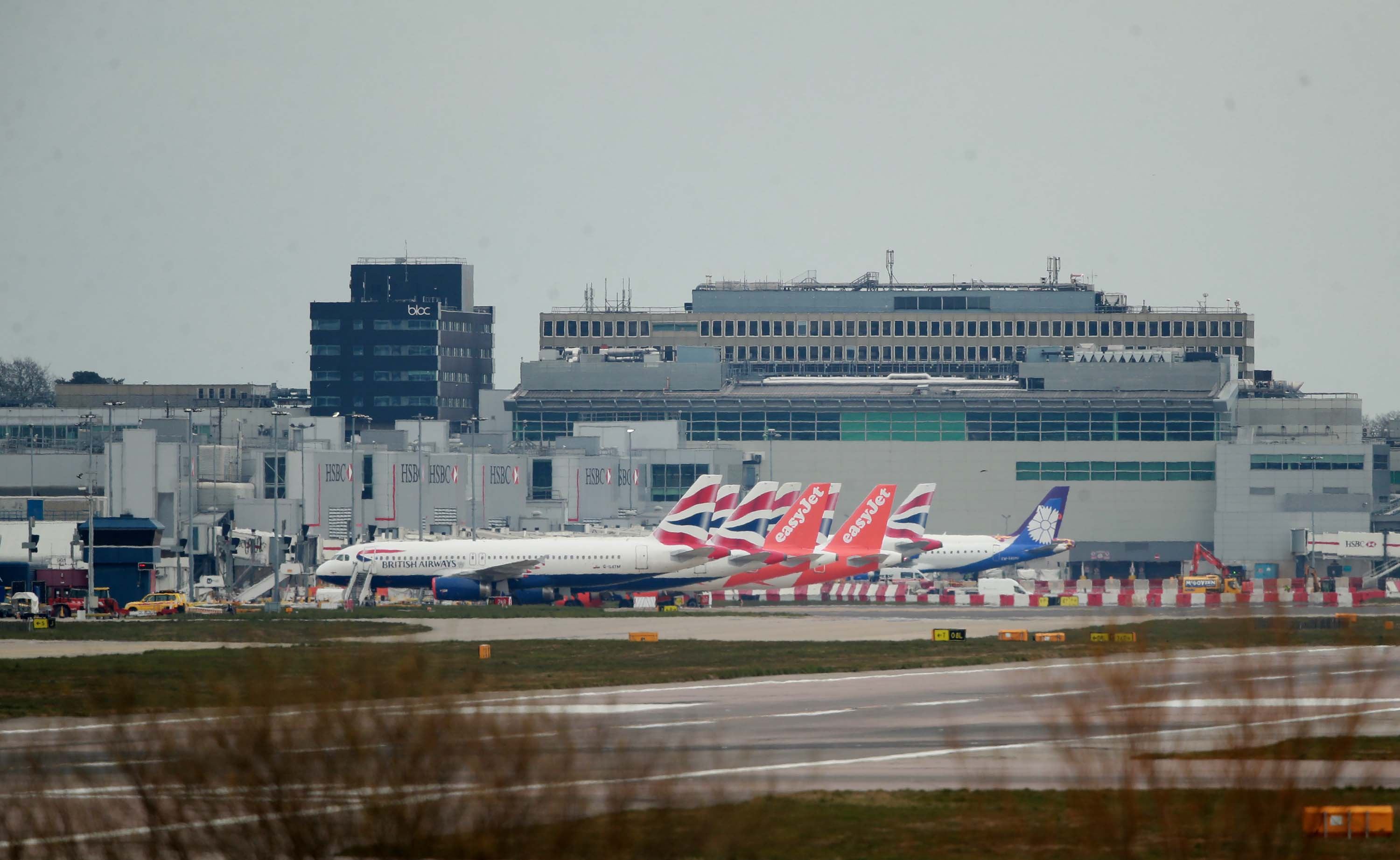 British Airways and easyJet planes are seen parked at Gatwick Airport in Crawley, England, on March 29.