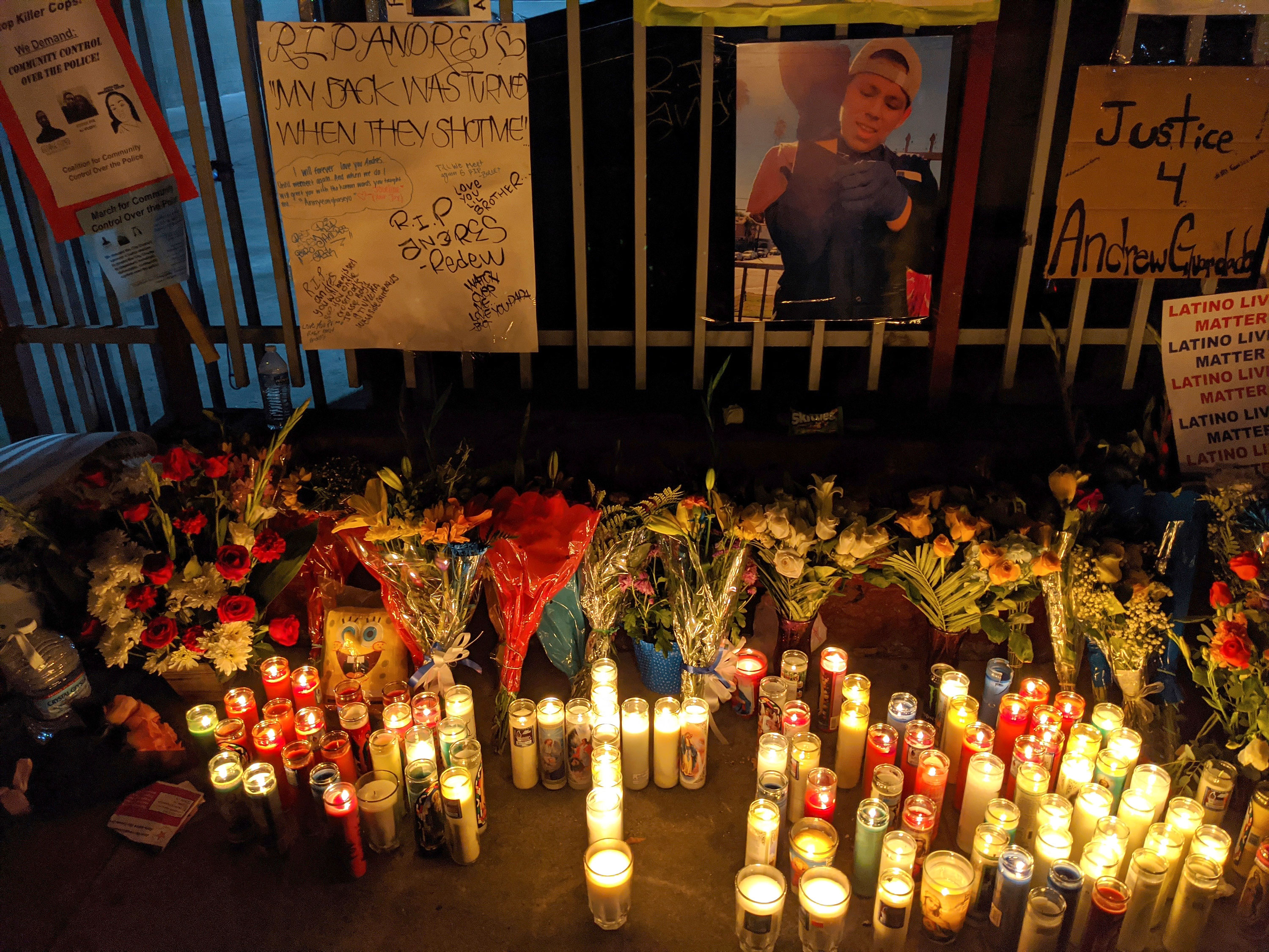 Candles and flowers are placed at a makeshift memorial for Andres Guardado on June 19 in Gardena, California.