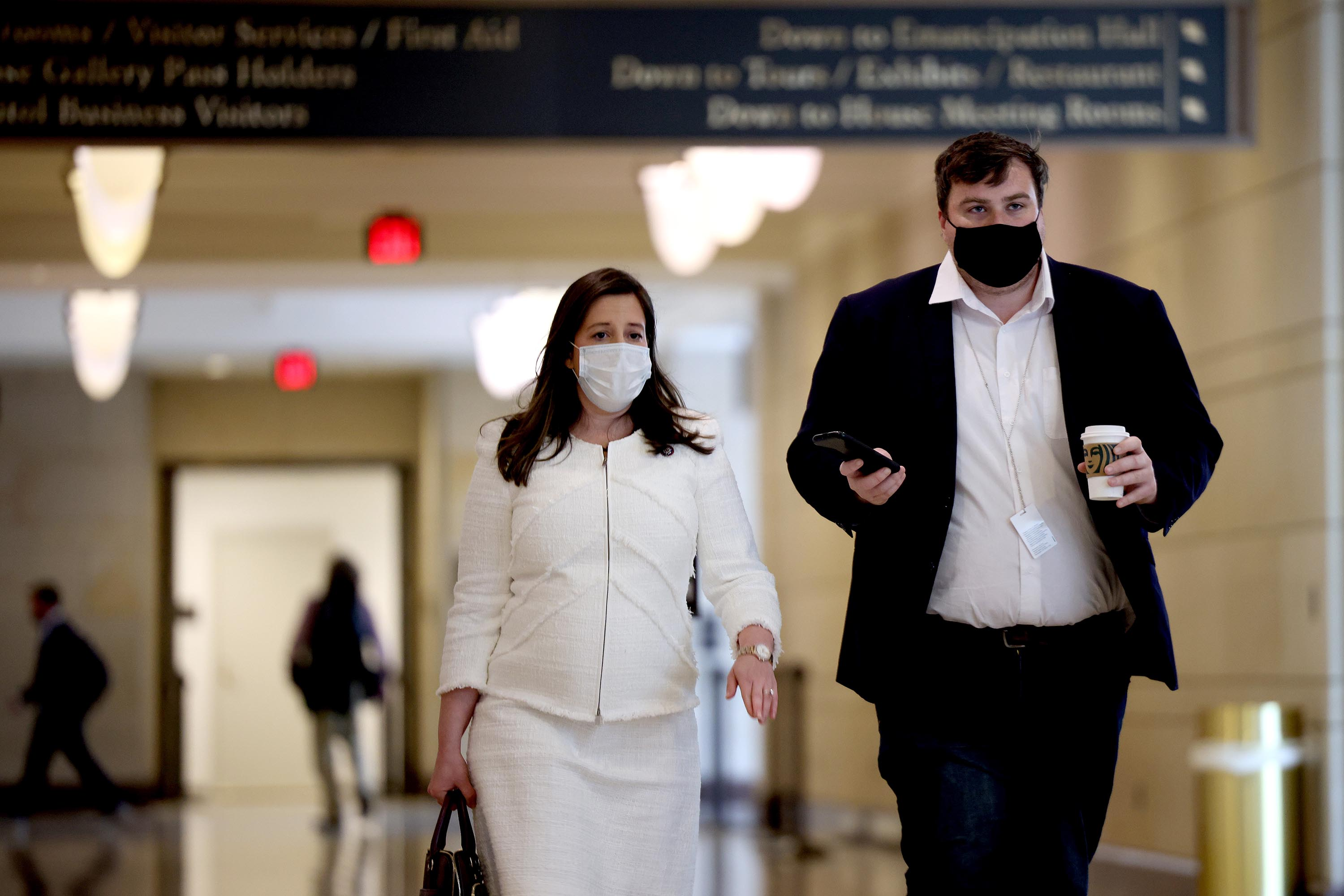 Rep. Elise Stefanik speaks with a reporter as she arrives for a caucus meeting in the U.S. Capitol Visitors Center on May 12, 2021 in Washington, DC.