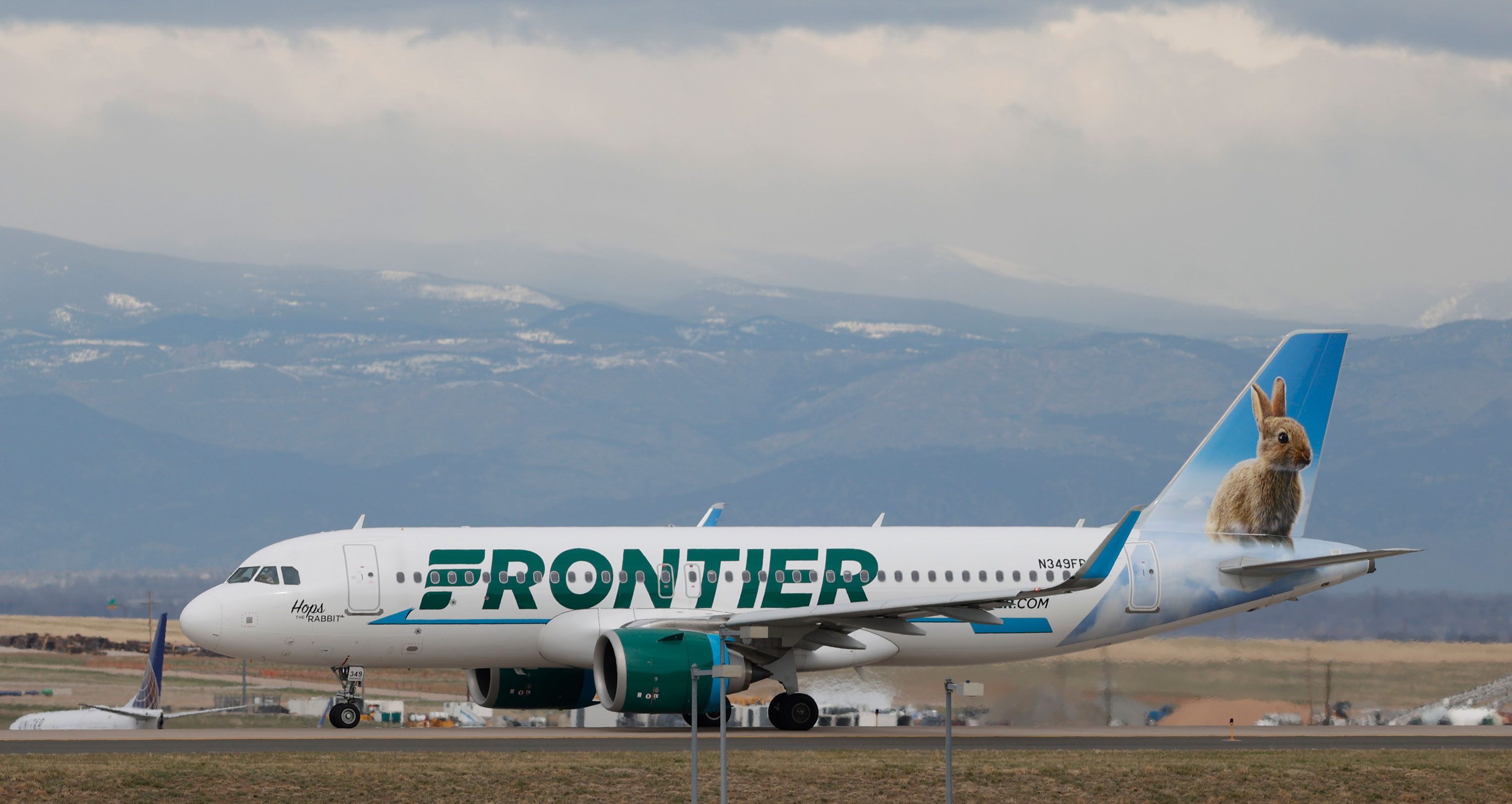 A Frontier Airlines jetliner taxis to a runway to take off from Denver International Airport on April 23, in Denver.