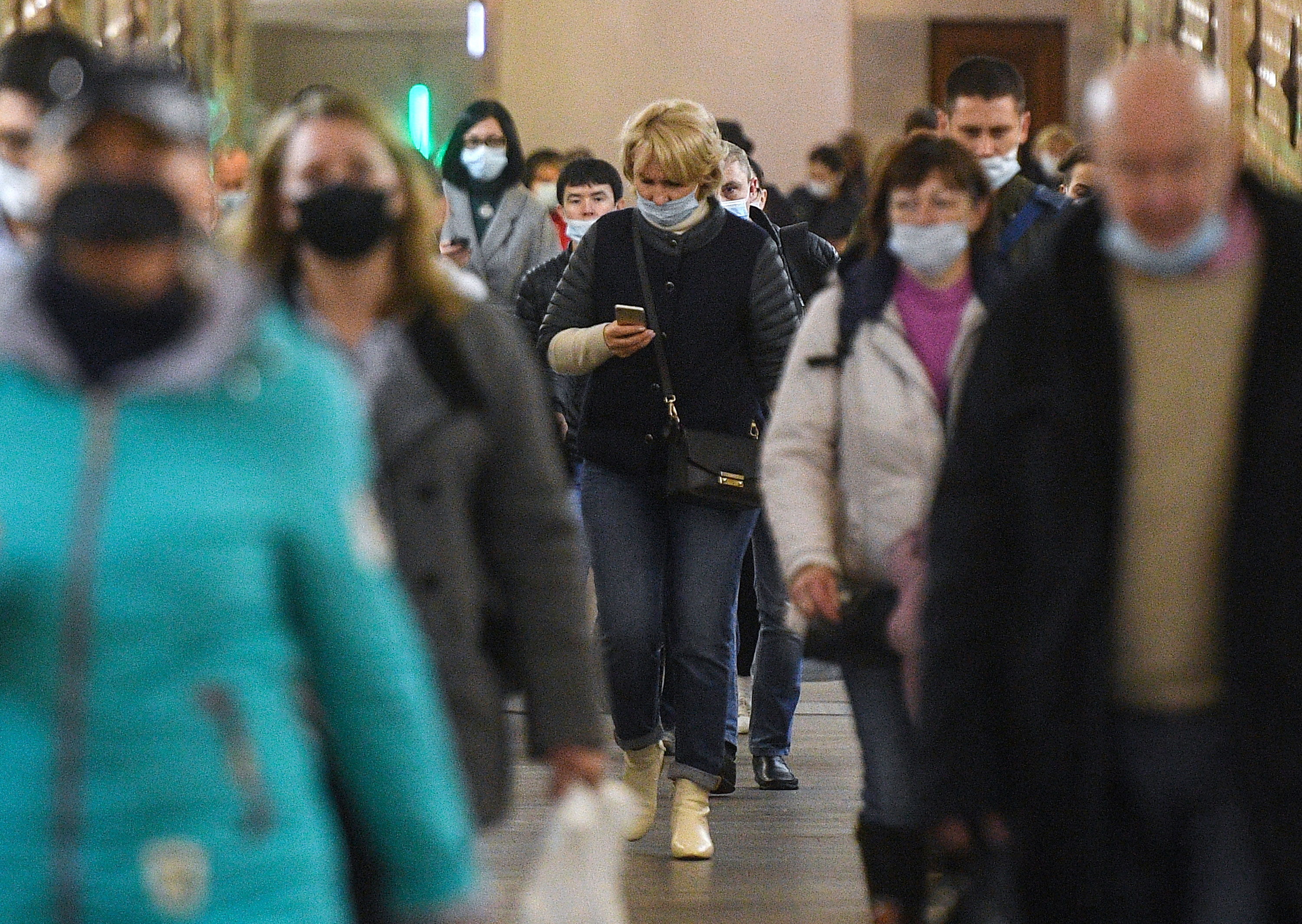 Passengers wear face masks at a metro station in Moscow, Russia, on October 23.