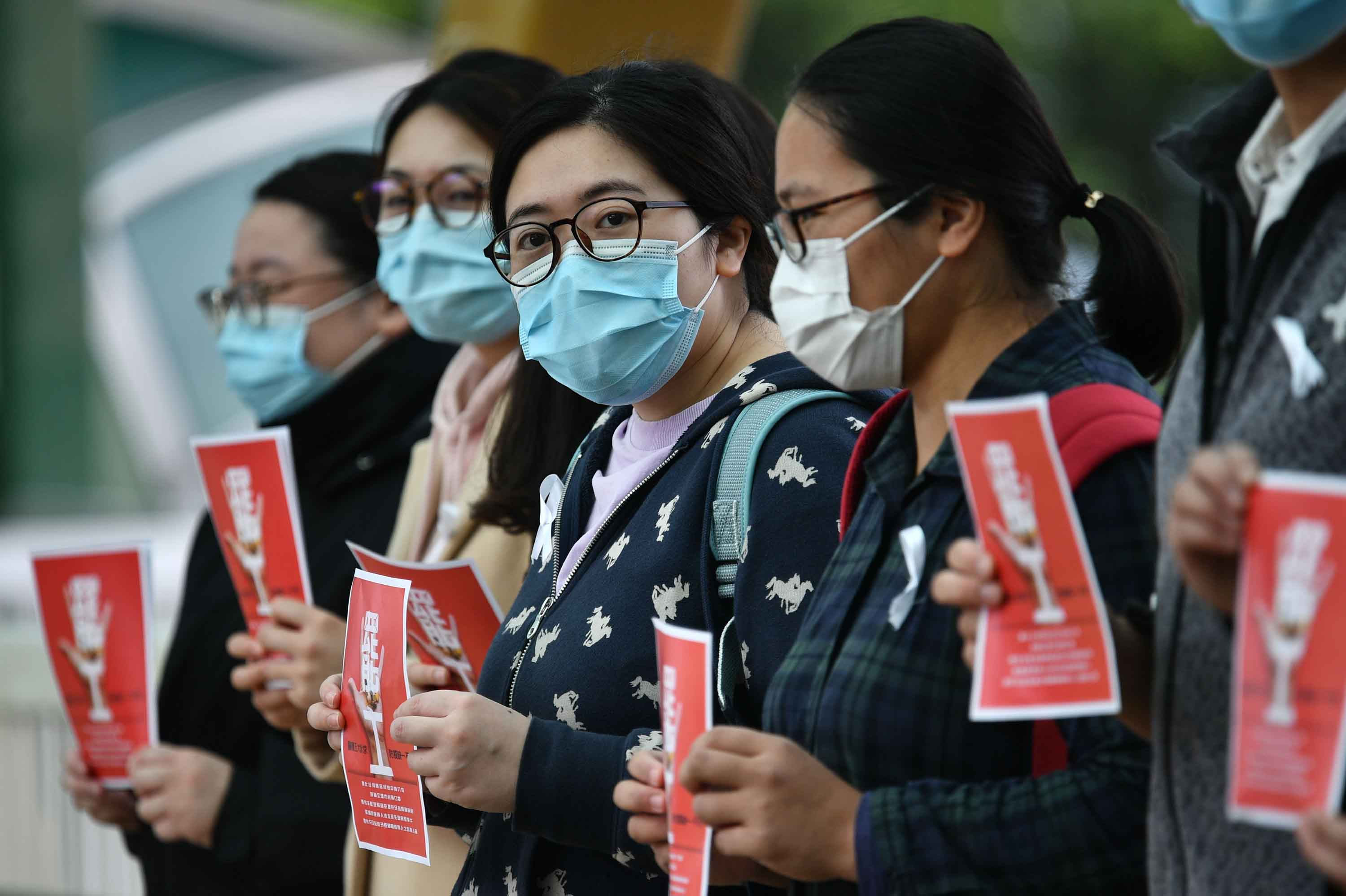 Local medical workers hold a strike near Queen Mary Hospital in Hong Kong on Friday.