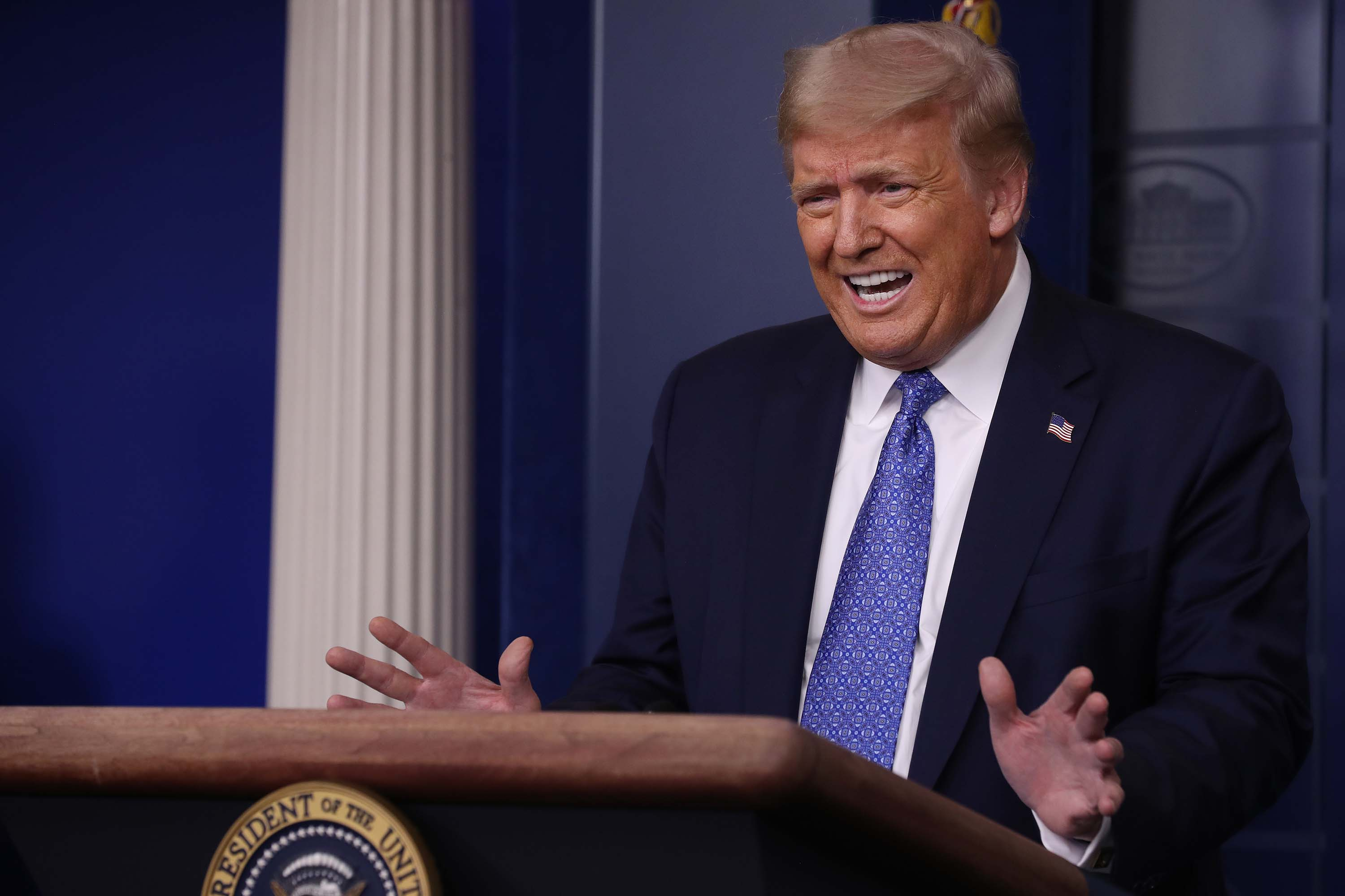 President Donald Trump talks to journalists during a July 22 news conference at the White House about his administration's response to the ongoing global coronavirus pandemic.