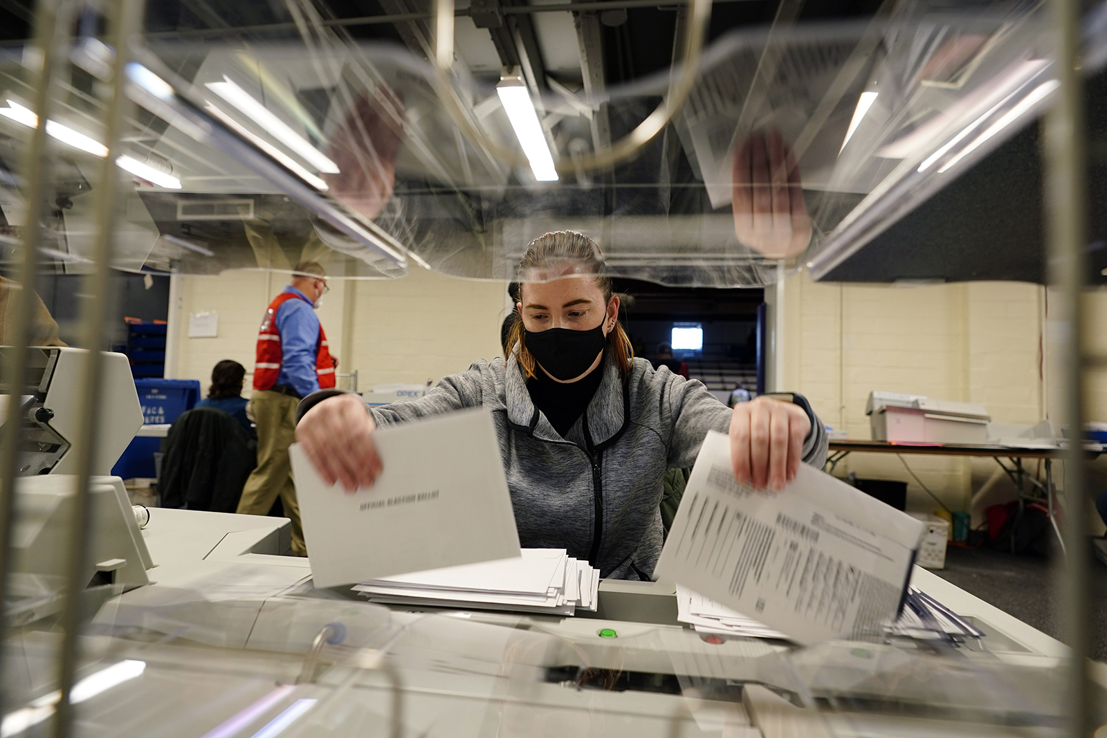 Chester County, Pennsylvania, election worker Kristina Sladek opens mail-in and absentee ballots for the 2020 General Election in the United States at West Chester University on Tuesday, November 3.