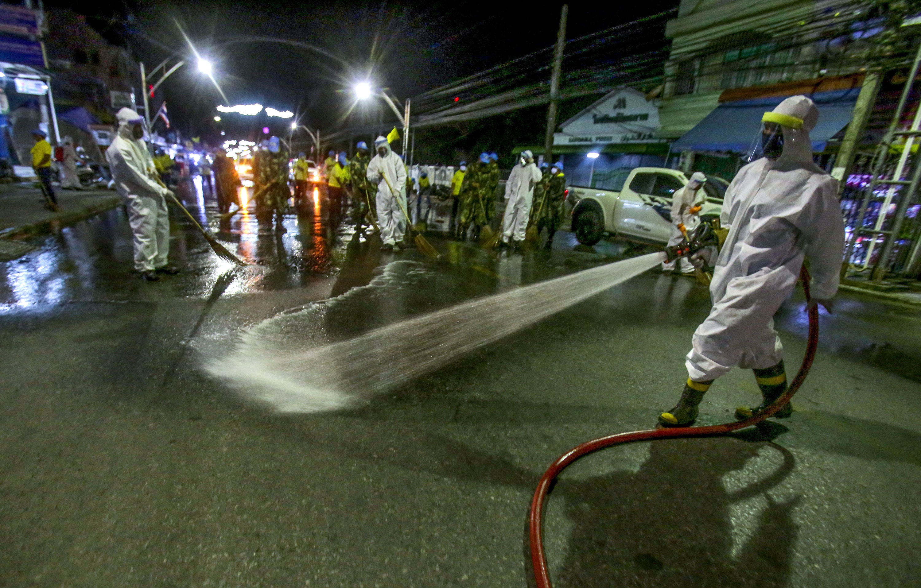 Royal Thai Army soldiers disinfect a road in Thailand's southern province of Pattani on April 4.