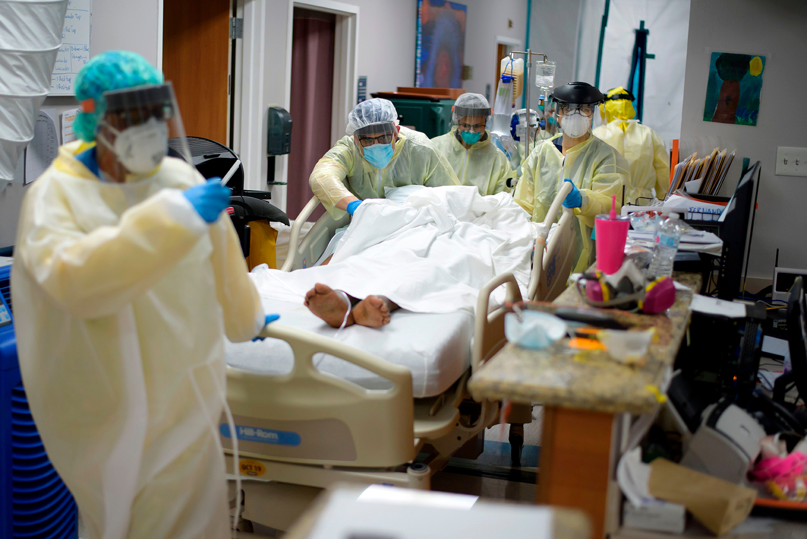 Healthcare workers move a patient in the Covid-19 Unit at United Memorial Medical Center in Houston on July 2.