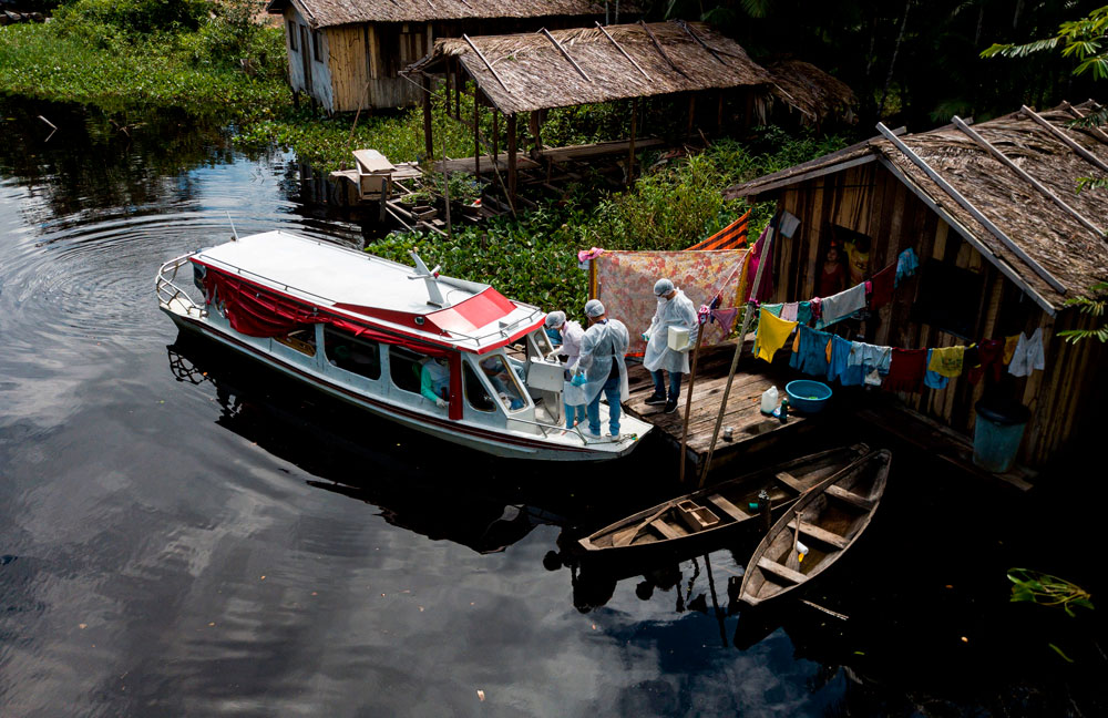 Health workers arrive with test kits in the Marajoara region at the mouth of the Amazon River in the state of Para, Brazil, on May 23.