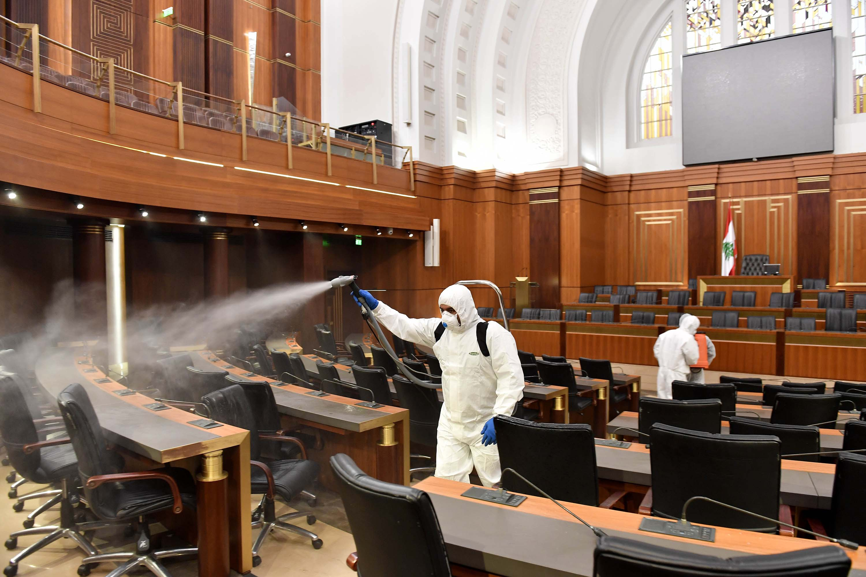 Health officials spray disinfectant at the Lebanese Parliament building in Beirut, Lebanon on Tuesday, as a precaution against the coronavirus.