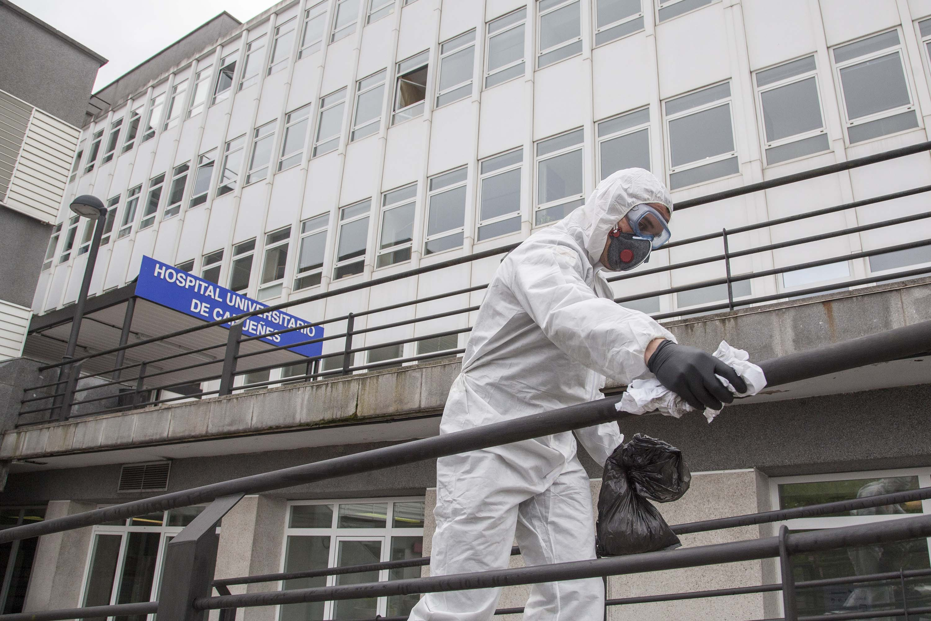 A member of Spain's UME (Military Emergency Unit) disinfects outside the Cabuenes hospital in Gijon, Spain on March 18.