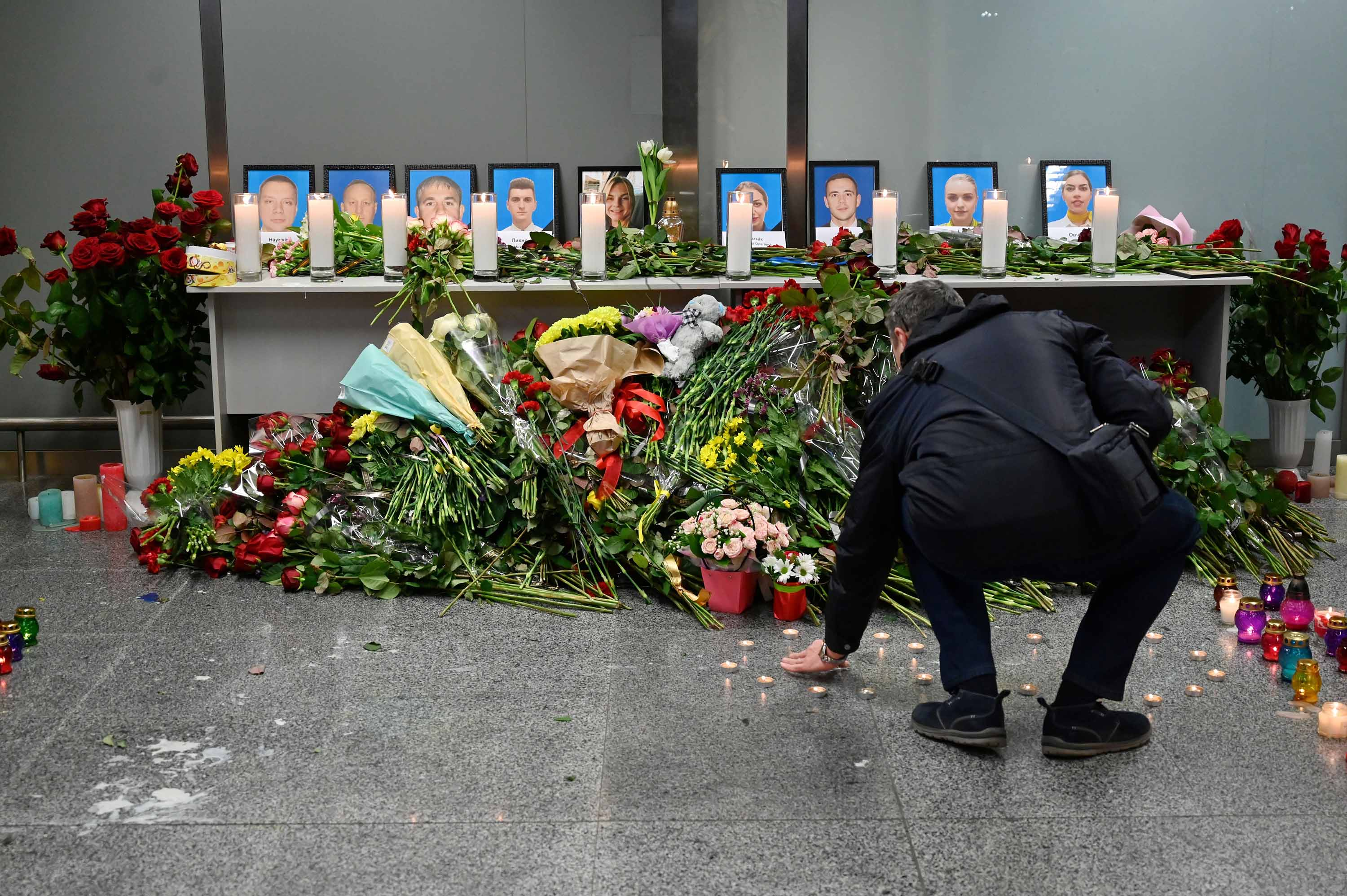 A man visits a memorial set up at the Boryspil airport outside Kiev, Ukraine for victims of the crash, on January 8.