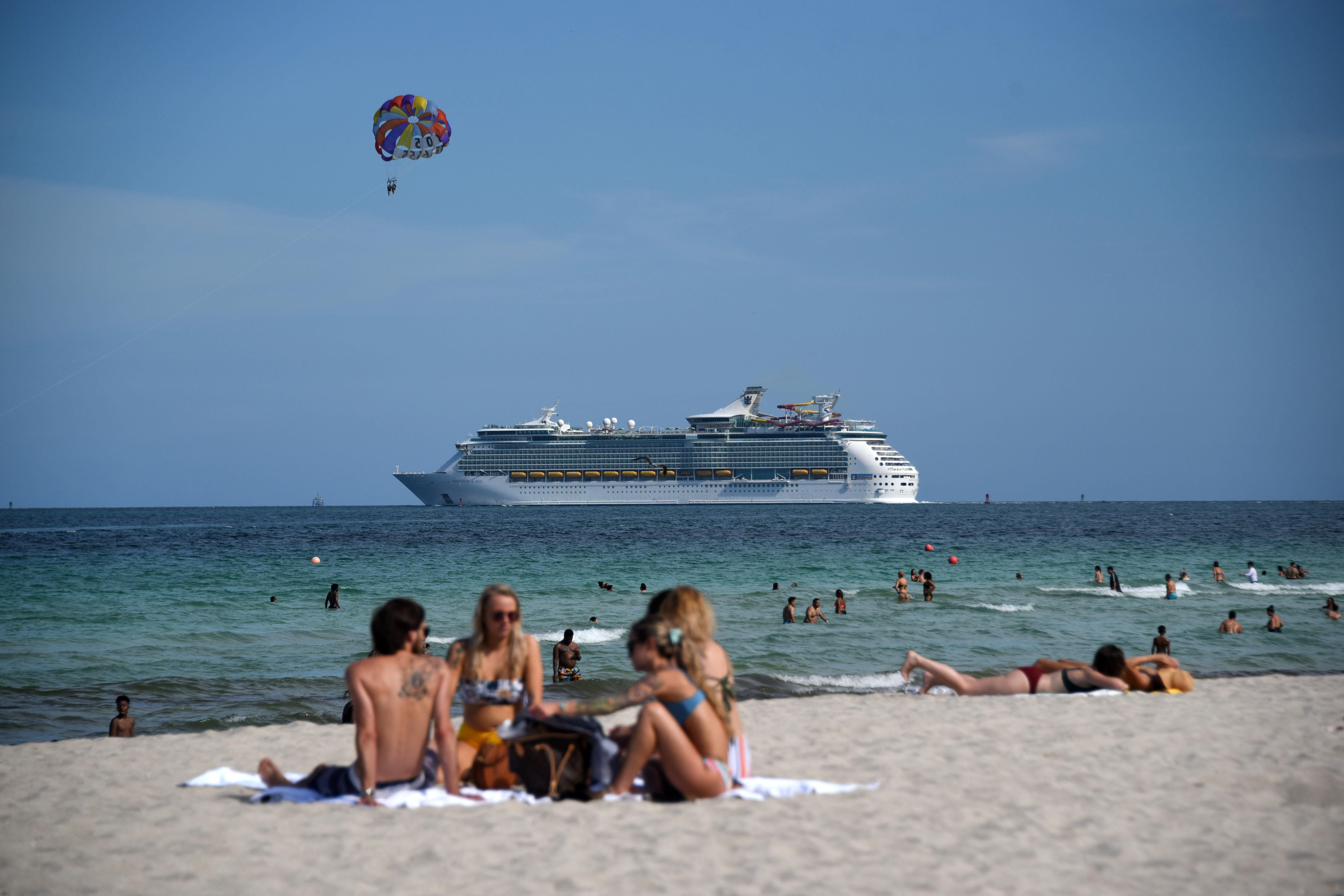 People visit Miami Beach, Florida, on June 22.