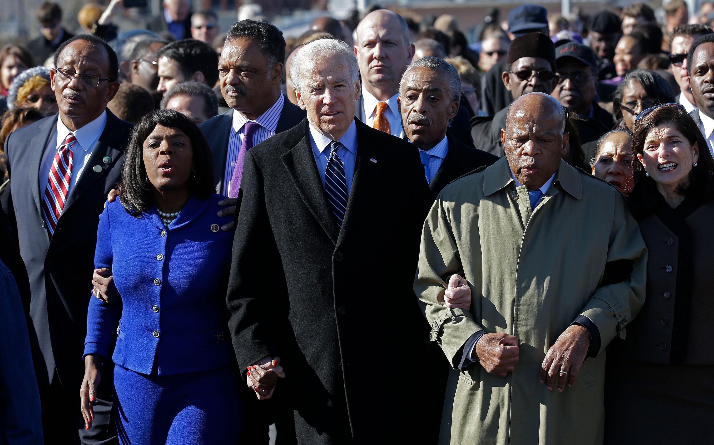 Vice President Joe Biden walks with Rep. John Lewis across the Edmund Pettus Bridge in Selma, Alabama, in March 2013.