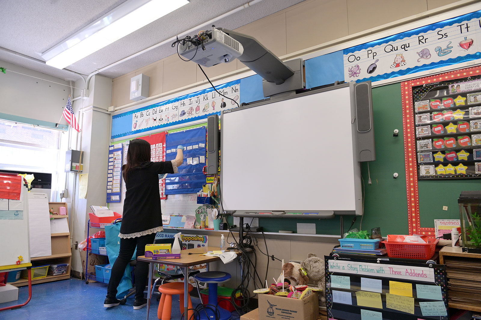 A teacher collects supplies from their classroom at P.S. 124 in New York City after the city's public schools shut down due to the coronavirus outbreak. New York City submitted its plan to reopen schools on Friday night.