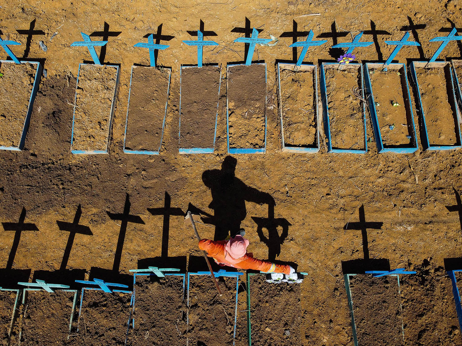 A gravedigger working at the Nossa Senhora Aparecida cemetery where Covid-19 victims are buried in Manaus, Brazil, on June 2.