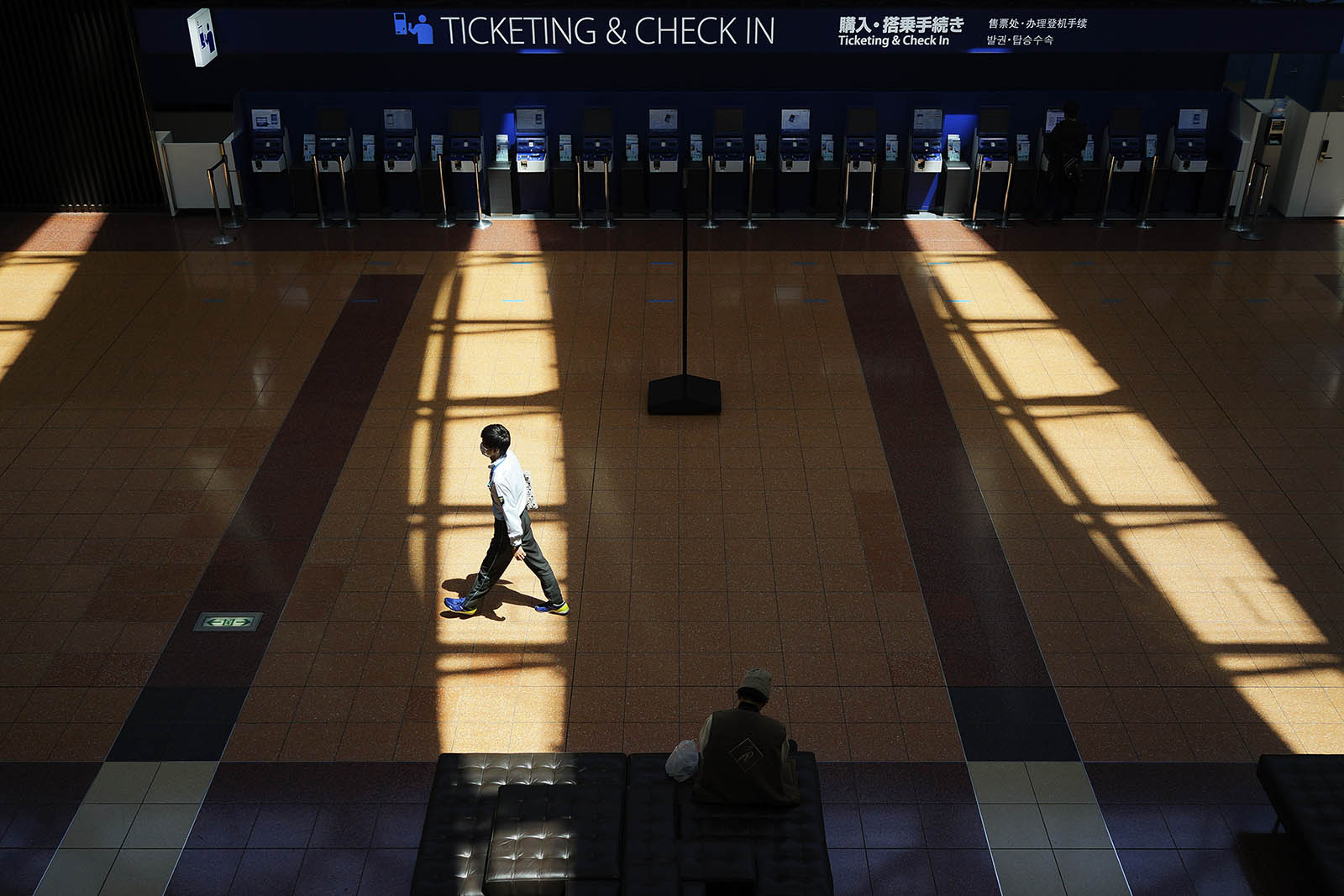 A passenger walks at an empty domestic terminal of Haneda Airport in Tokyo, at the start of Golden Week holiday Wednesday, on April 29.