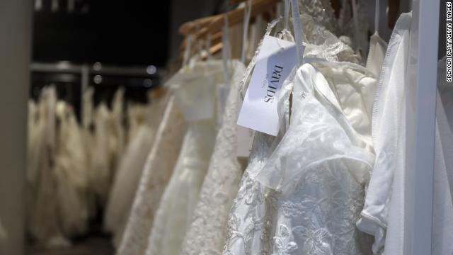 Wedding dresses are displayed in a window at a David's Bridal store in Manhattan.