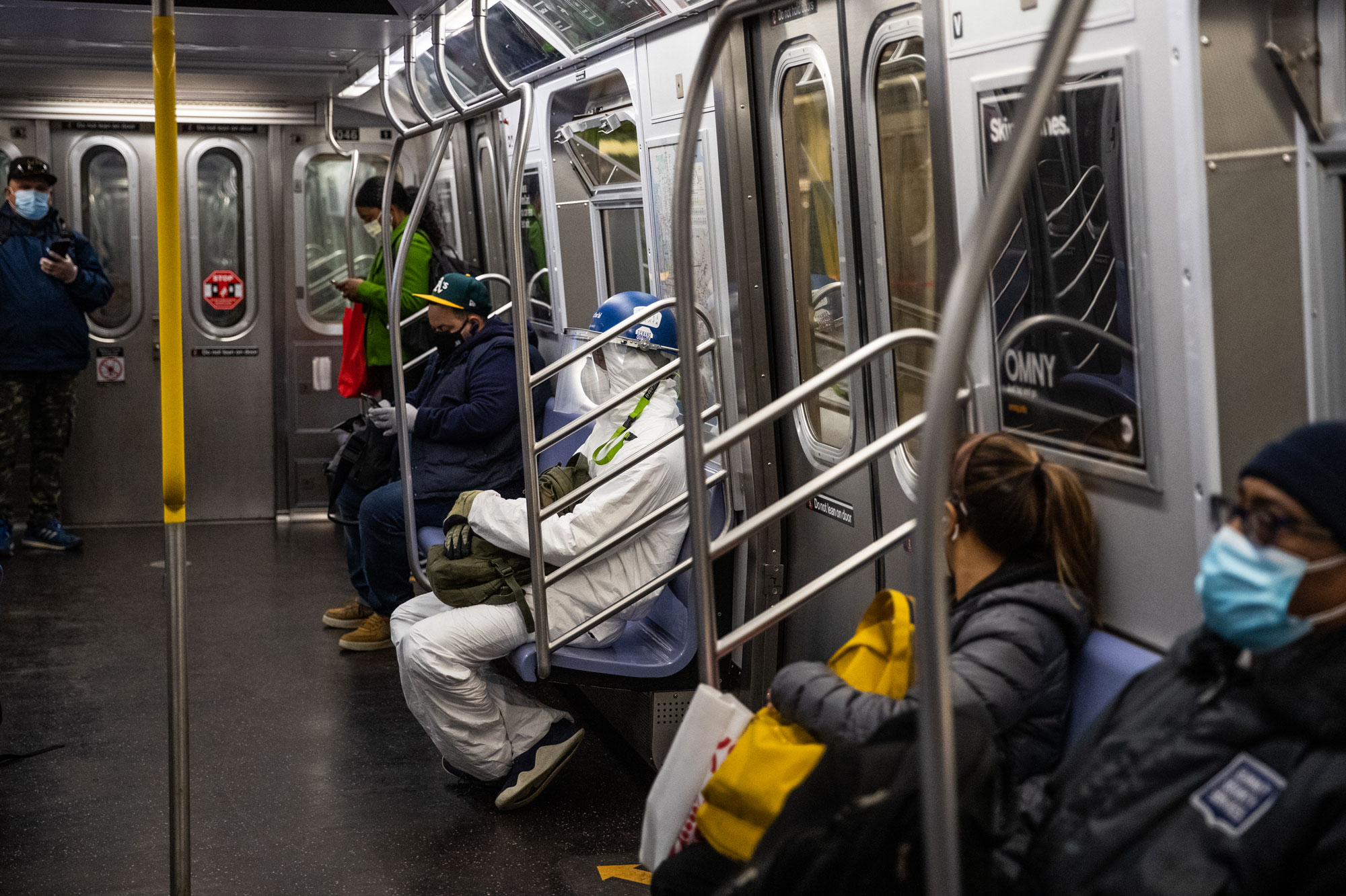 Passengers ride the subway on April 28, in New York City.