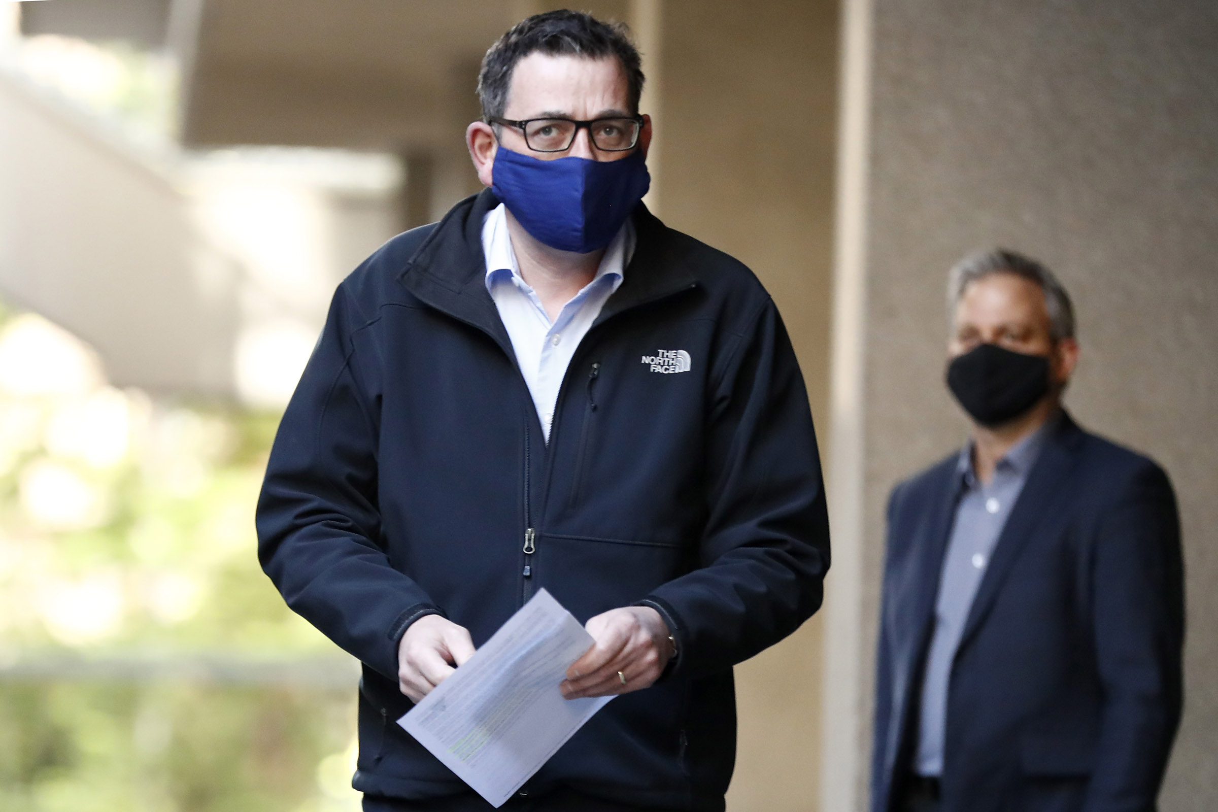 Victorian Premier Daniel Andrews wears a face mask as he walks in to the daily briefing on July 19, in Melbourne, Australia.
