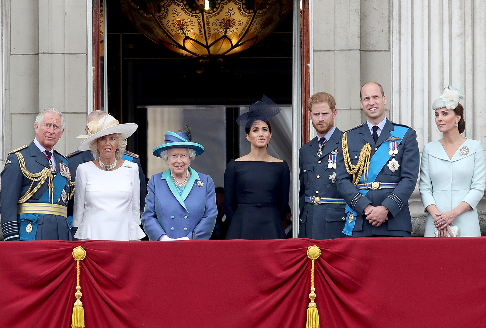 Prince Charles, Prince of Wales, Camilla, Duchess of Cornwall, Queen Elizabeth II, Meghan, Duchess of Sussex, Prince Harry, Duke of Sussex, Prince William, Duke of Cambridge and Catherine, Duchess of Cambridge watch the RAF flypast on the balcony of Buckingham Palace, as members of the Royal Family attend events to mark the centenary of the RAF on July 10, 2018 in London, England.