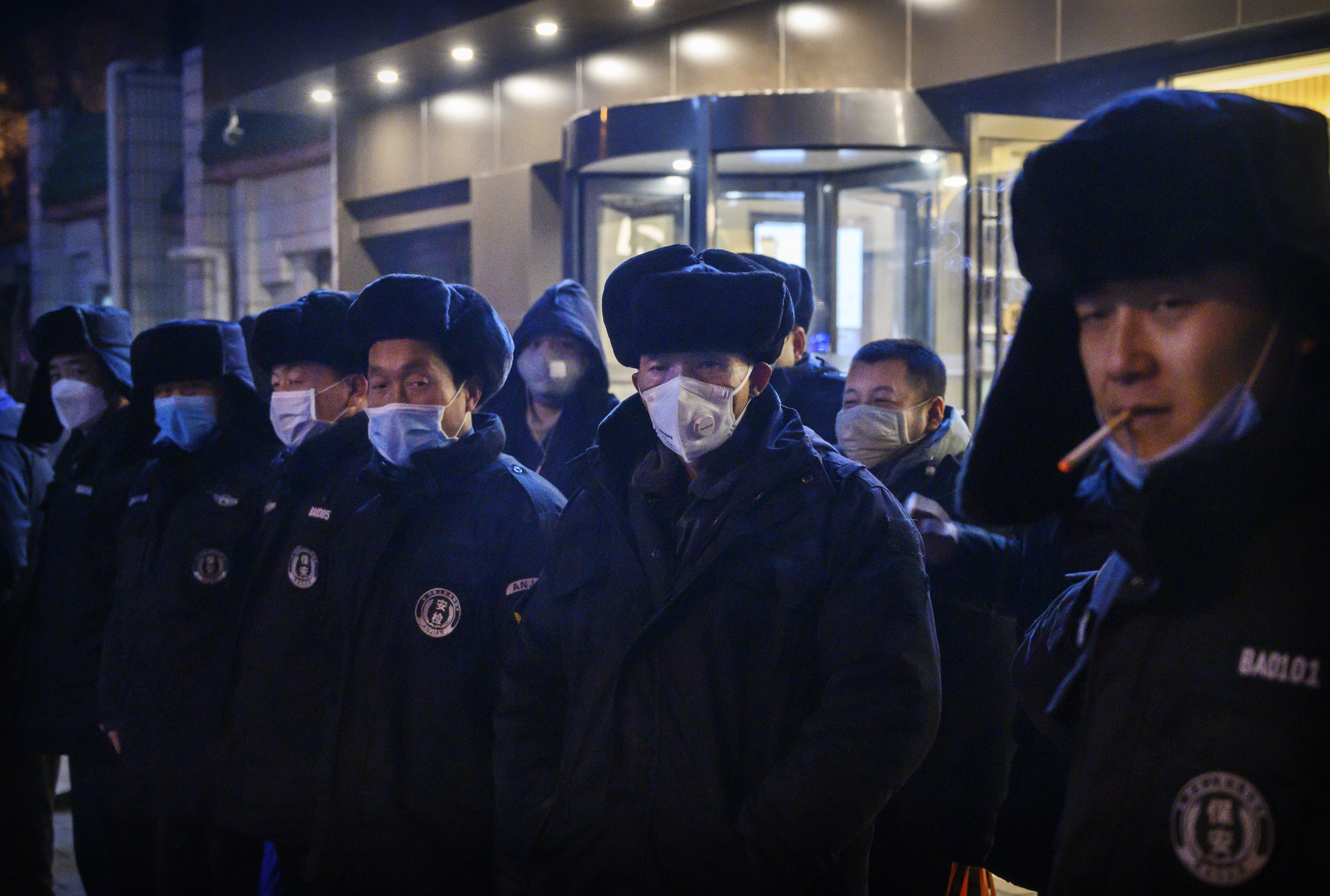 Chinese security guards line up before duty on February 9, 2020 in Beijing, China.