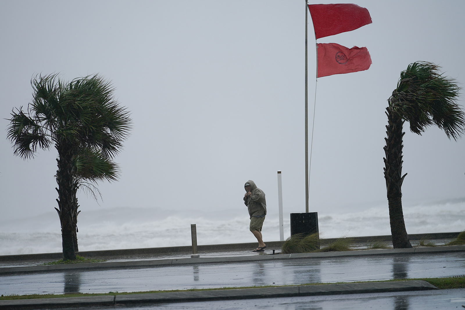 A man walks bear the gulf as Hurricane Sally moves in on Tuesday in Gulf Shores, Alabama.