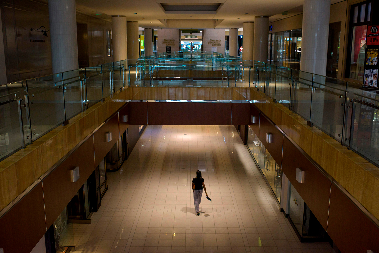 A lone shopper walks around The Galleria shopping center on May 1, in Houston, Texas.