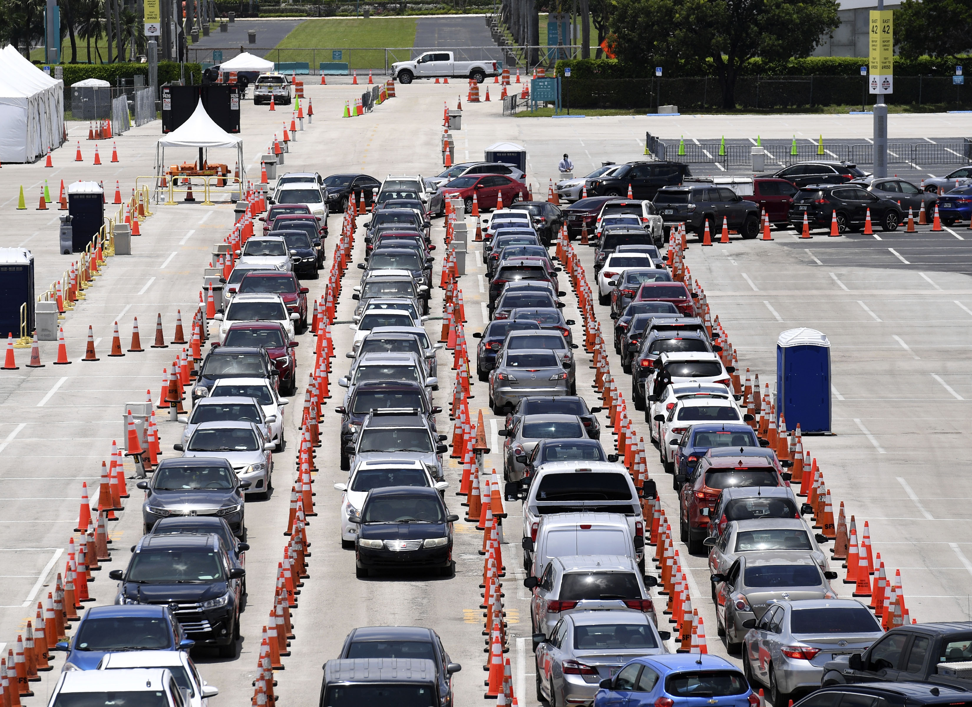 Cars wait in line at a drive-thru Covid-19 testing site at the Miami Beach Convention Center in Florida on July 10.