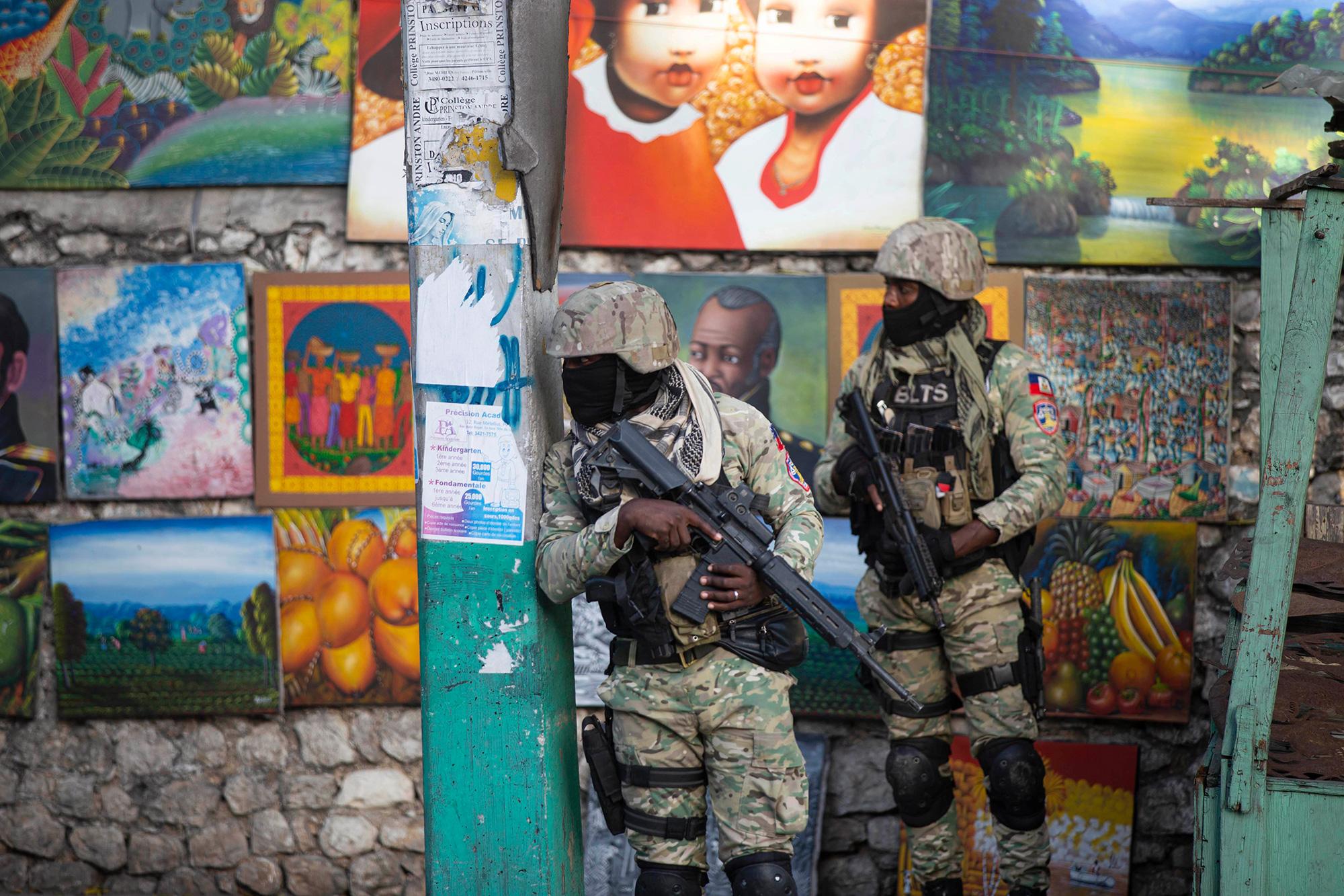 Soldiers patrol the Petion Ville neighborhood of Port-au-Prince on Wednesday.