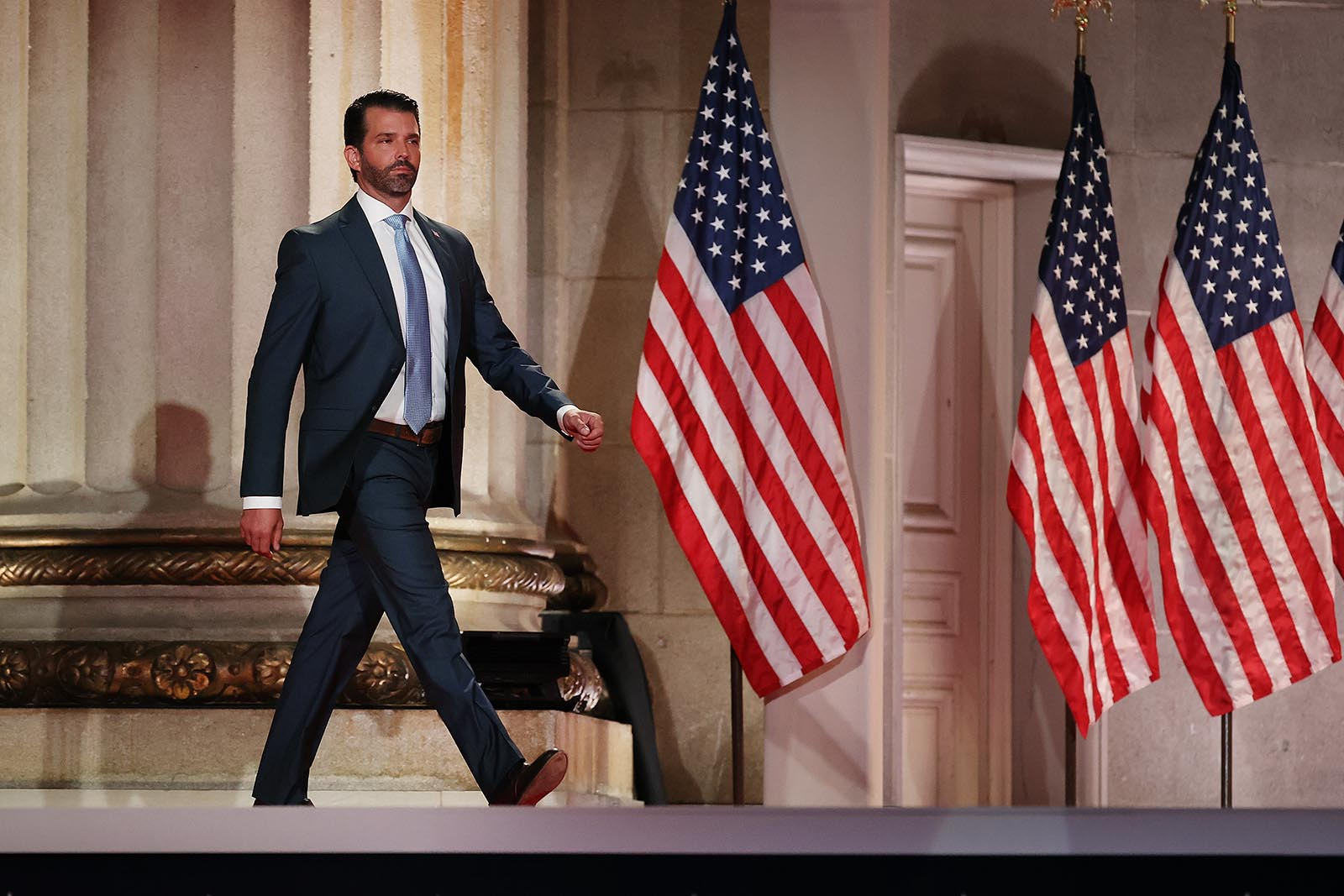 Donald Trump Jr. steps out on stage before pre-recording his address to the Republican National Convention at the Mellon Auditorium on August 24, in Washington.