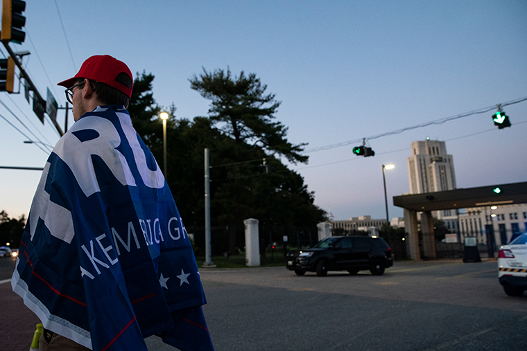 A supporter of U.S. President Donald Trump stands outside Walter Reed National Military Medical Center on October 2, 2020 in Bethesda, Maryland.