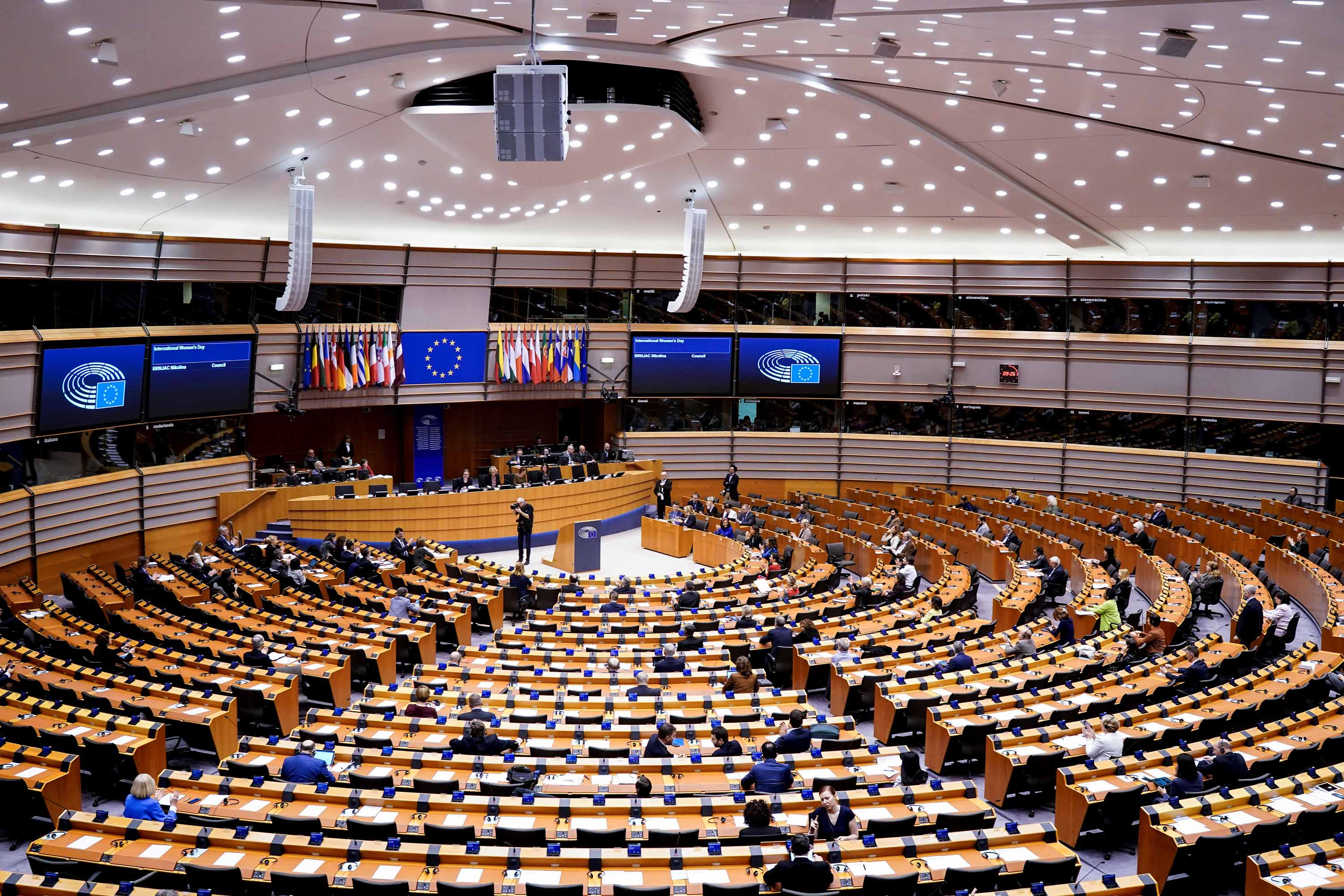Members of the EU Parliament arrive at the beginning of a plenary session in Brussels on Tuesday, which has been reduced to a single day due to the coronavirus outbreak.