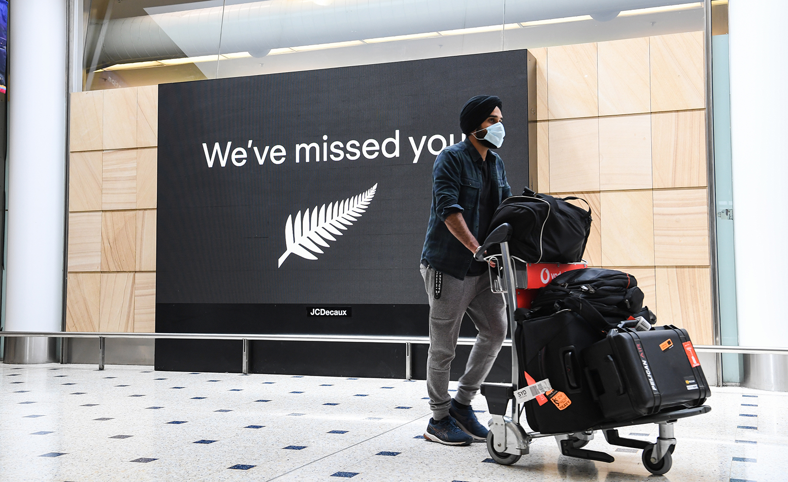 A passenger from Auckland, New Zealand arrives at Sydney's Kingsford Smith Airport in Sydney, Australia, on Oct. 16.