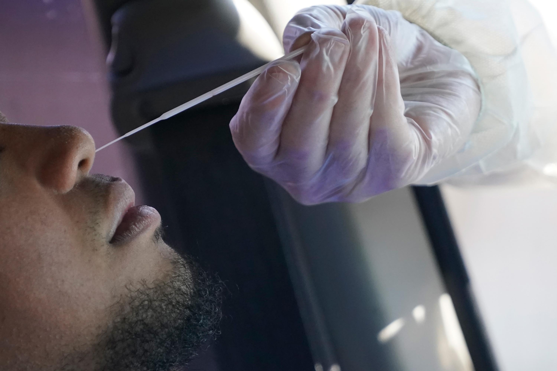 A Salt Lake County Health Department public health nurse performs a coronavirus test outside the Salt Lake County Health Department on November 3 in Salt Lake City.