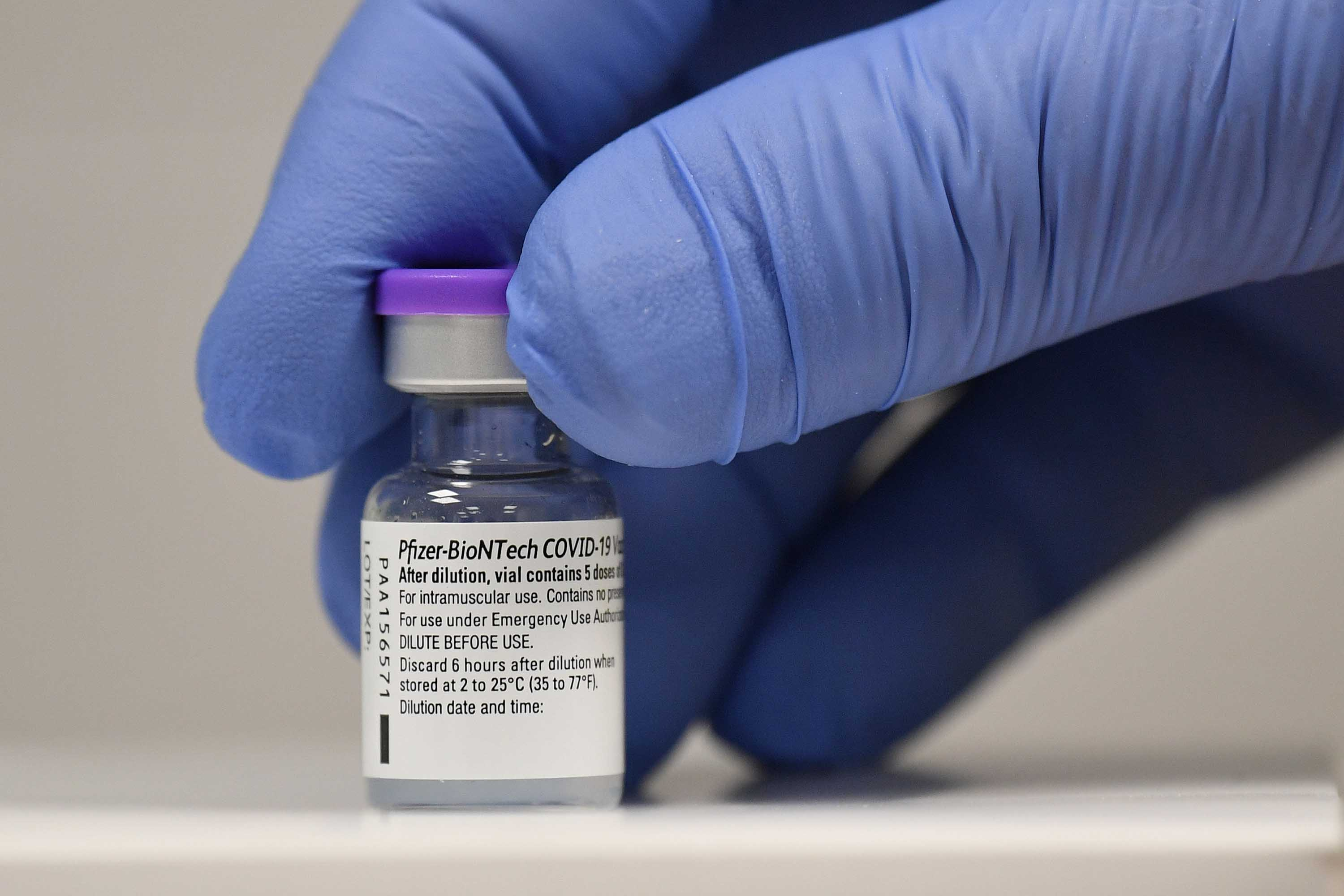 A phial of Pfizer-BioNTech Covid-19 vaccine is pictured at a vaccination center in Cardiff, Wales, on December 8.