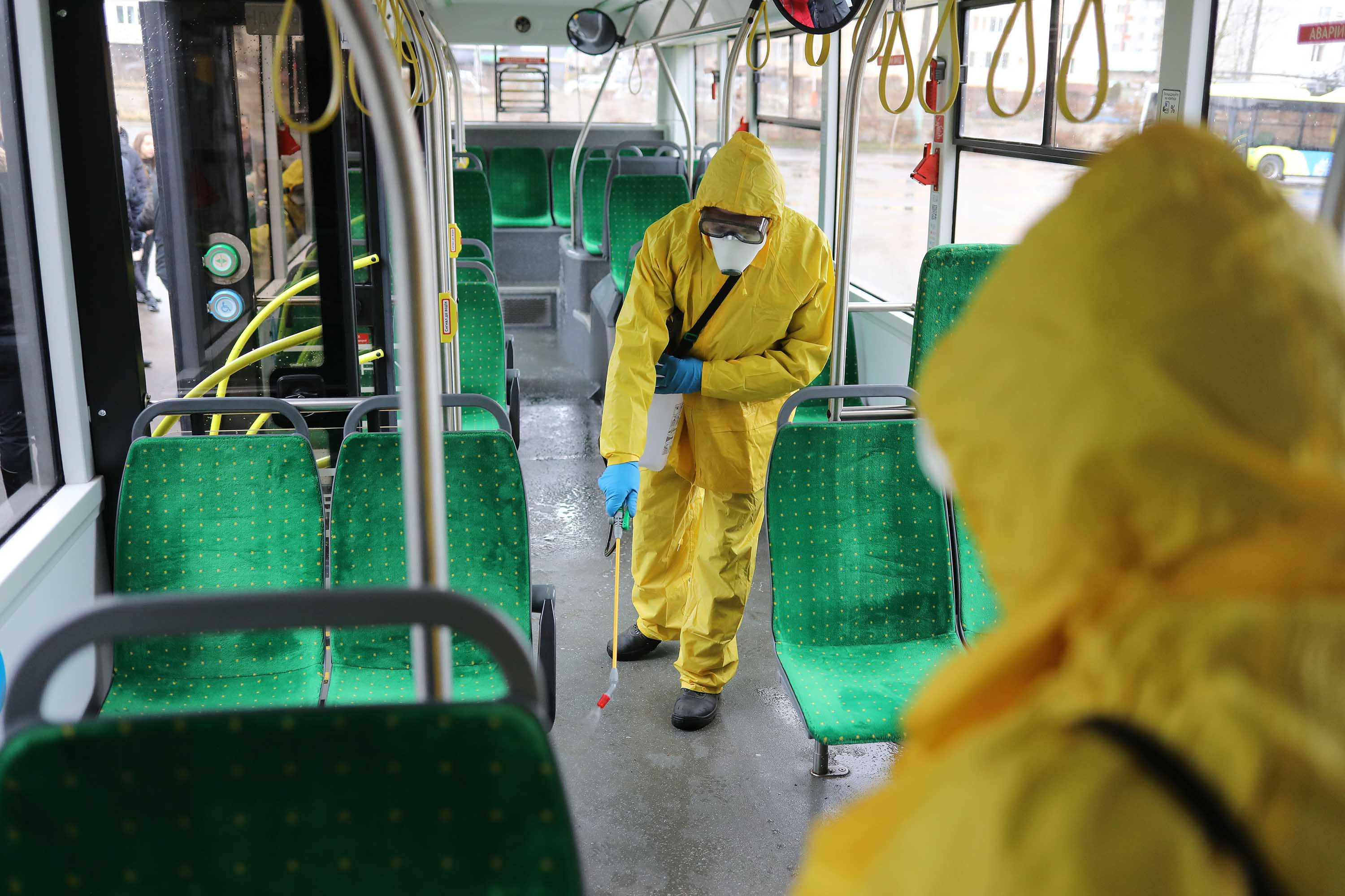 Workers in protective suits disinfect a bus in Lviv, Ukraine on March 2.