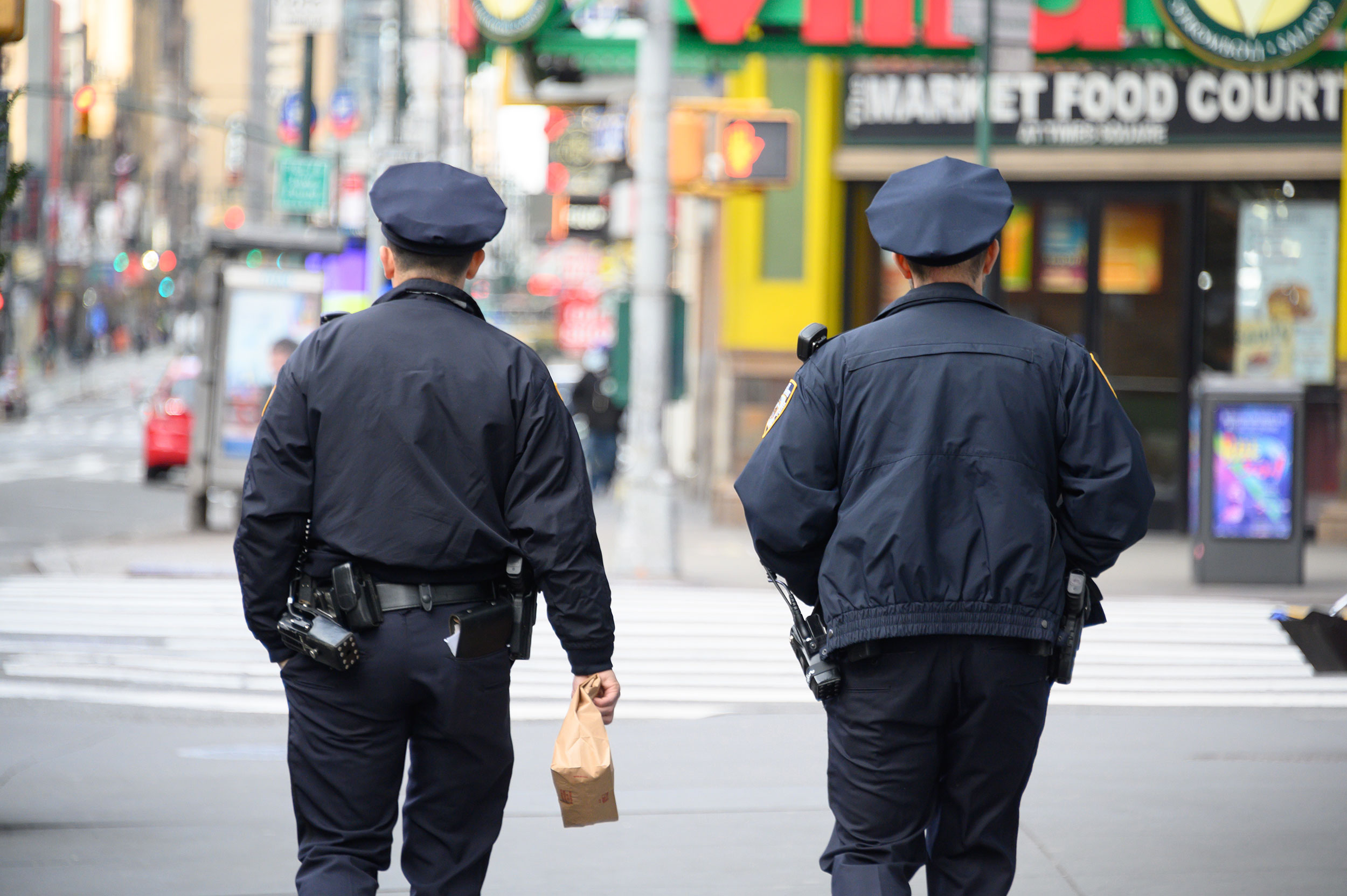 Two NYPD officers walk through Times Square on March 22.