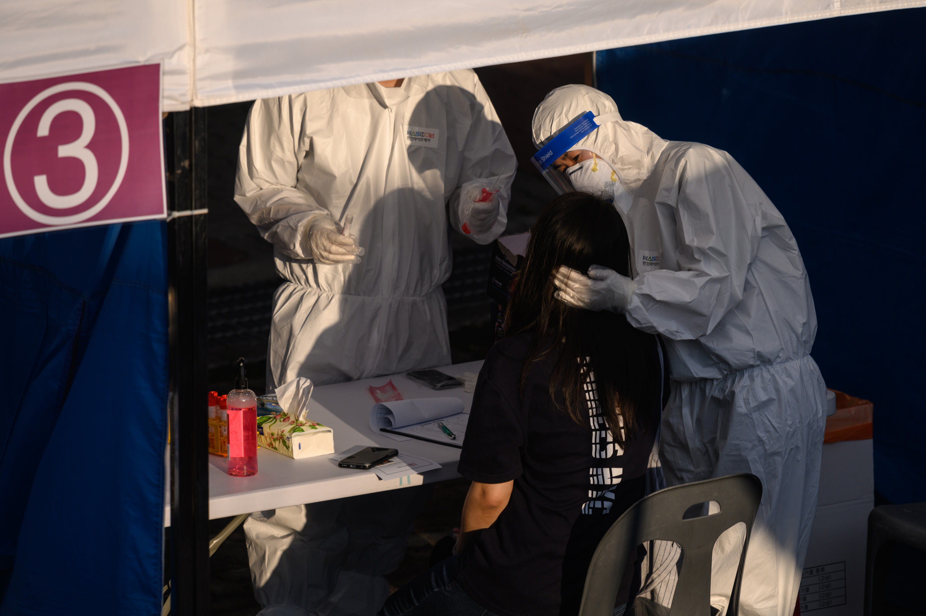A health worker administers a swab at a temporary coronavirus testing centre in Bucheon, South Korea, on May 27.
