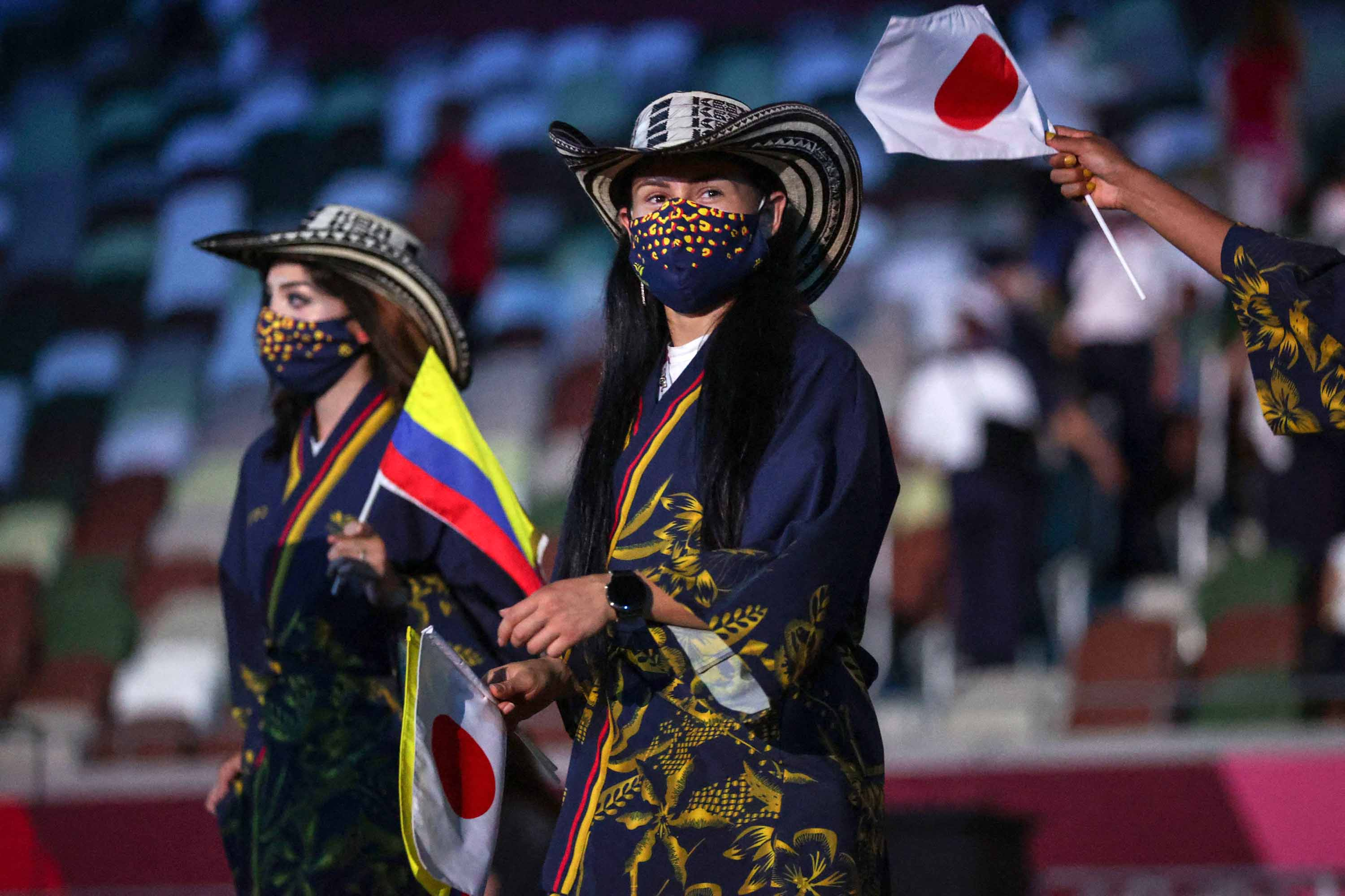 Members of Colombia's delegation enter the Olympic Stadium during the Opening Ceremony.