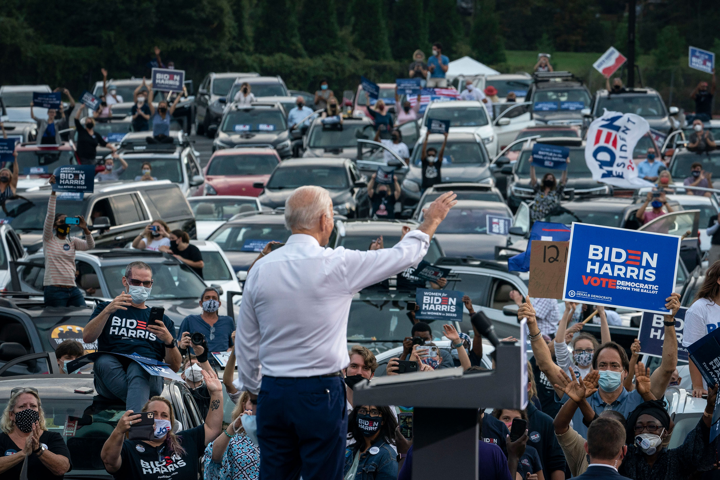 Joe Biden waves to supporters as he finishes speaking during a drive-in campaign rally in Atlanta on October 27.